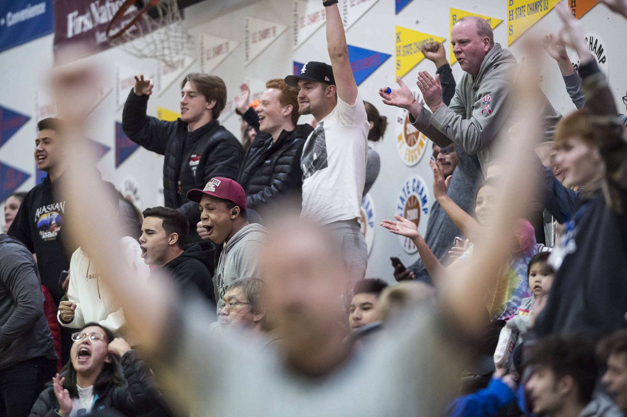 Former Juneau-Douglas' players and fans celebrate a three-point shot against Lathrop at the Princess Cruises Capital City Classic at Juneau-Douglas High School on Thursday, Dec. 27, 2018. Juneau-Douglas won 69-45. (Michael Penn | Juneau Empire)
