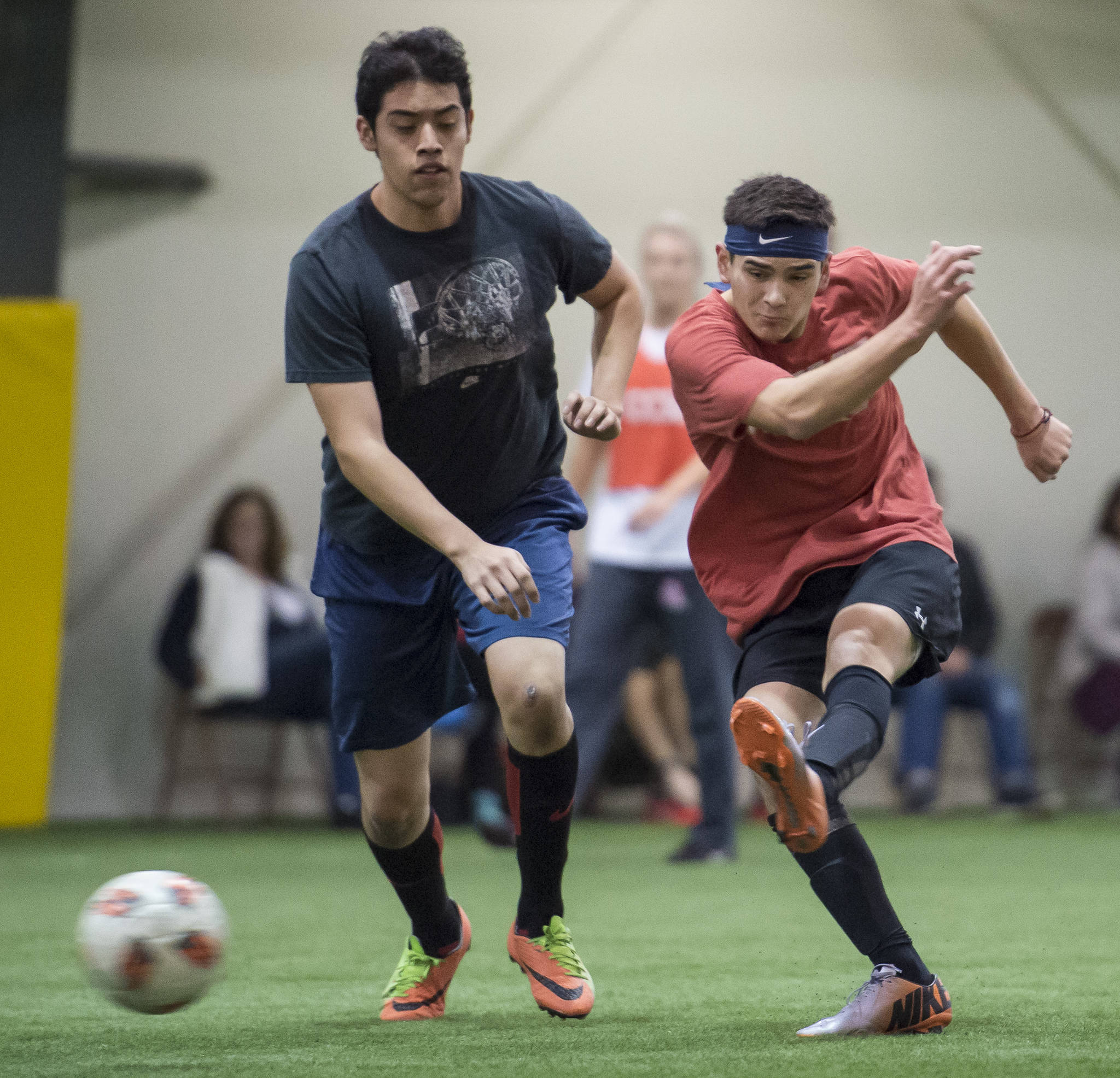 Grinch Gang, red, competes against Black Ice, black, in the finals of the senior division at the annual Holiday Cup Soccer Tournament at the Wells Fargo Dimond Park Field House on Monday, Dec. 31, 2018. The Grinch Gang won 8-2. (Michael Penn | Juneau Empire)