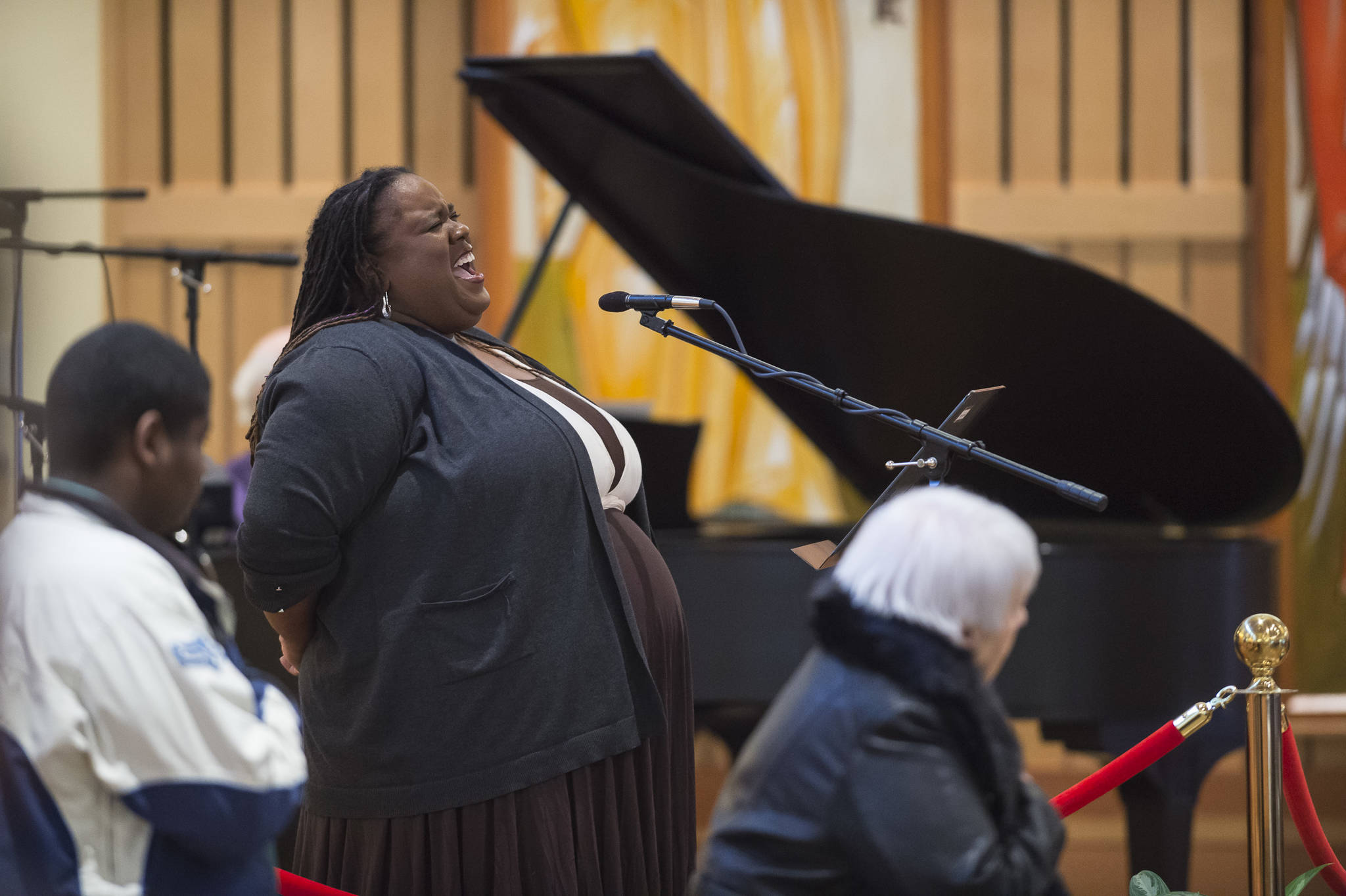 Jocelyn Miles sings the National Anthem at the Dr. Martin Luther King Jr. 2019 Community Celebration at St. Paul's Catholic Church on Monday, Jan. 21, 2019. (Michael Penn | Juneau Empire)