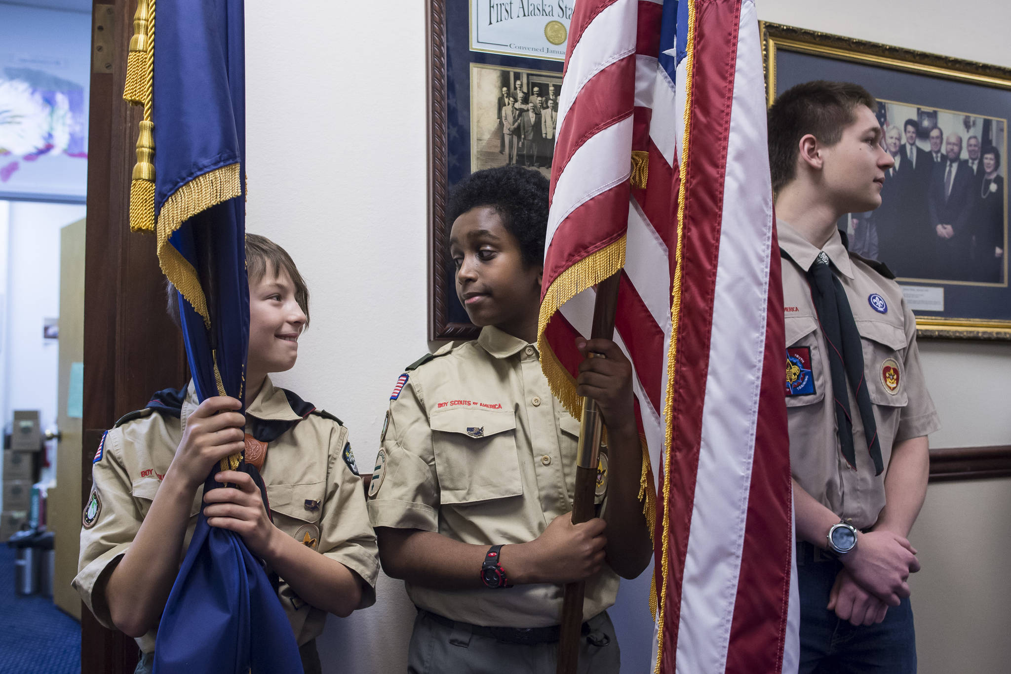 Boys Scouts wait to present the colors on the opening day of the 31st Session of the Alaska Legislature on Tuesday, Jan. 15, 2019. (Michael Penn | Juneau Empire)