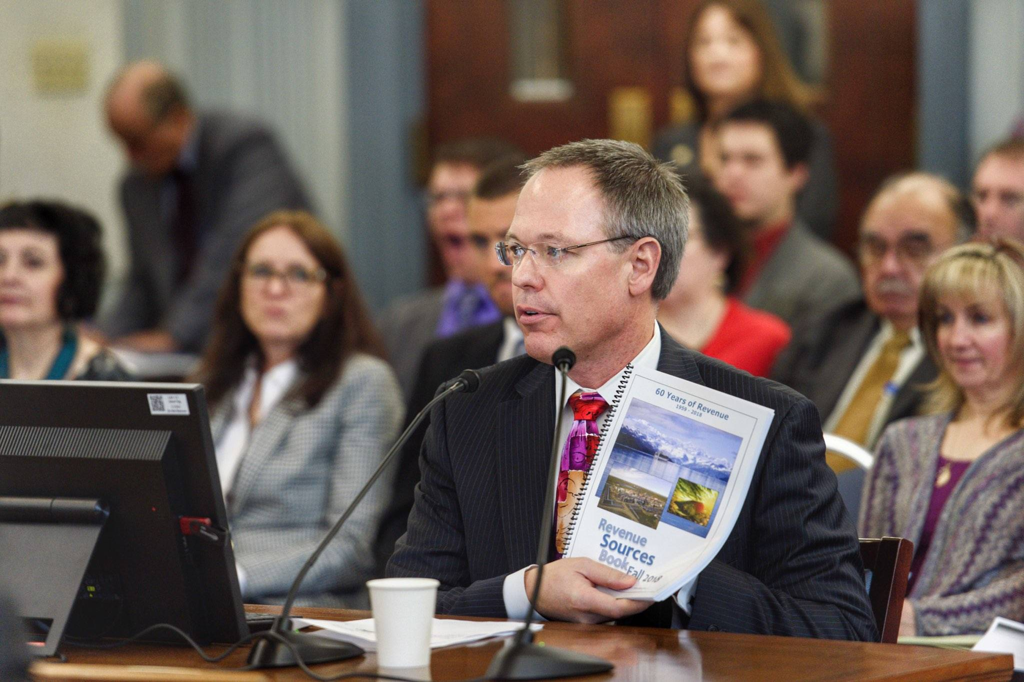 Commissioner Designee Bruce Tangeman presents the state's revenue forecast to the Senate Finance Committee at the Capitol on Wednesday, Jan. 16, 2019. (Michael Penn | Juneau Empire)