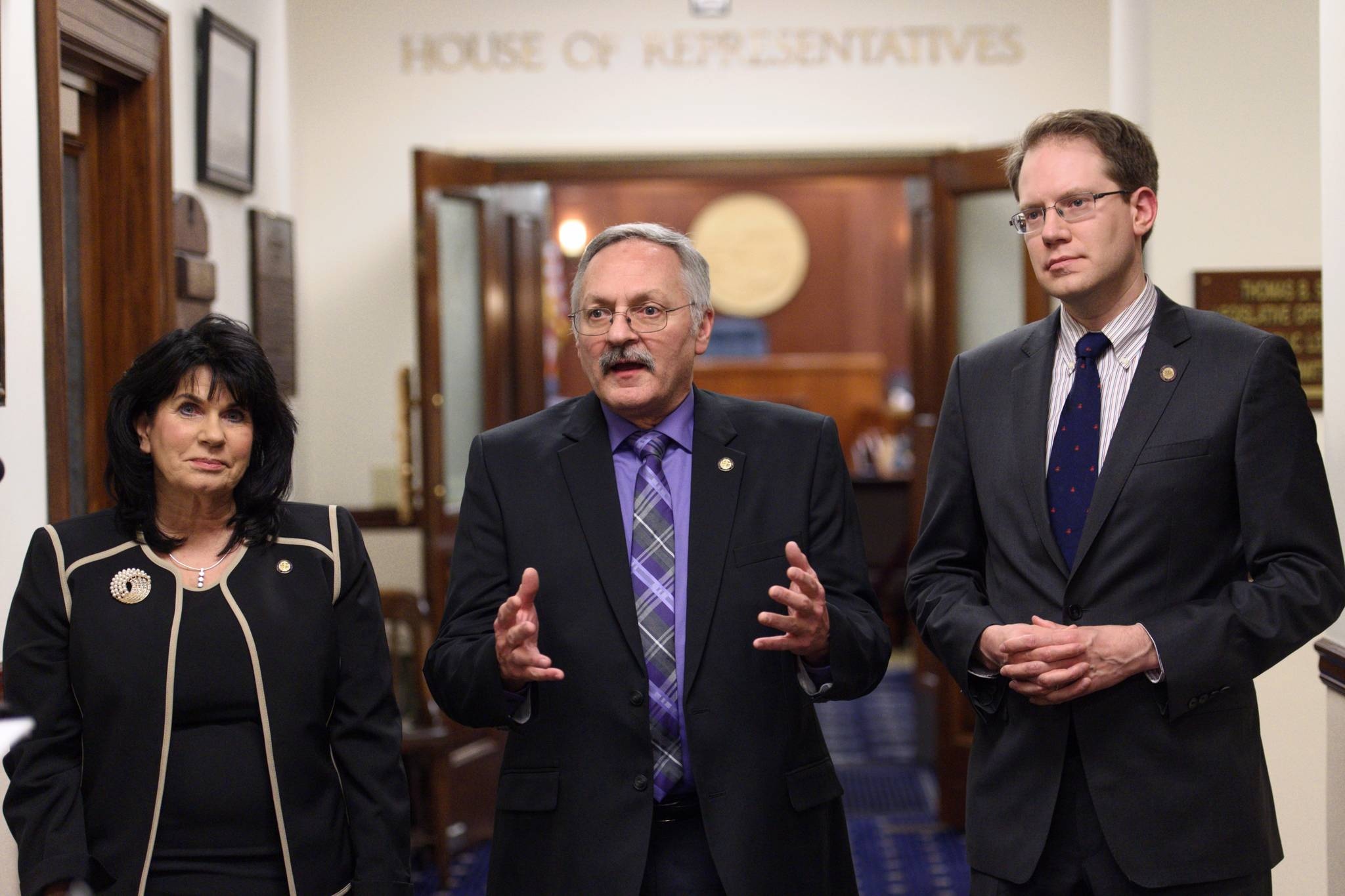 House Republicans Cathy Tilton, left, David Talerico, center, and Lance Pruitt speak to the press outside the House chambers after Gov. Mike Dunleavy's State of the State speech on Tuesday. (Michael Penn | Juneau Empire)