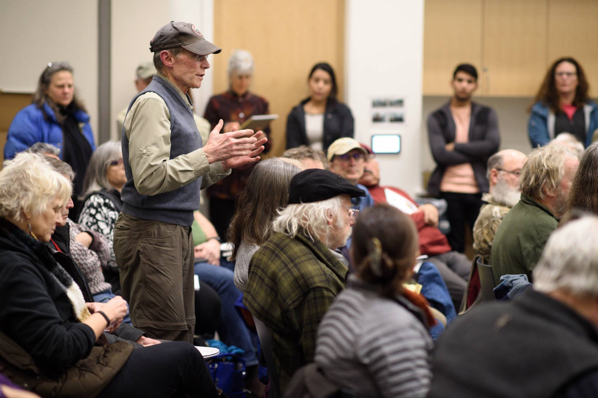 Gene Miller speaks up during a standing-room only town hall meeting featuring Juneau's new legislators at the Mendenhall Valley Public Library on Tuesday, Jan. 29, 2019. (Michael Penn | Juneau Empire)