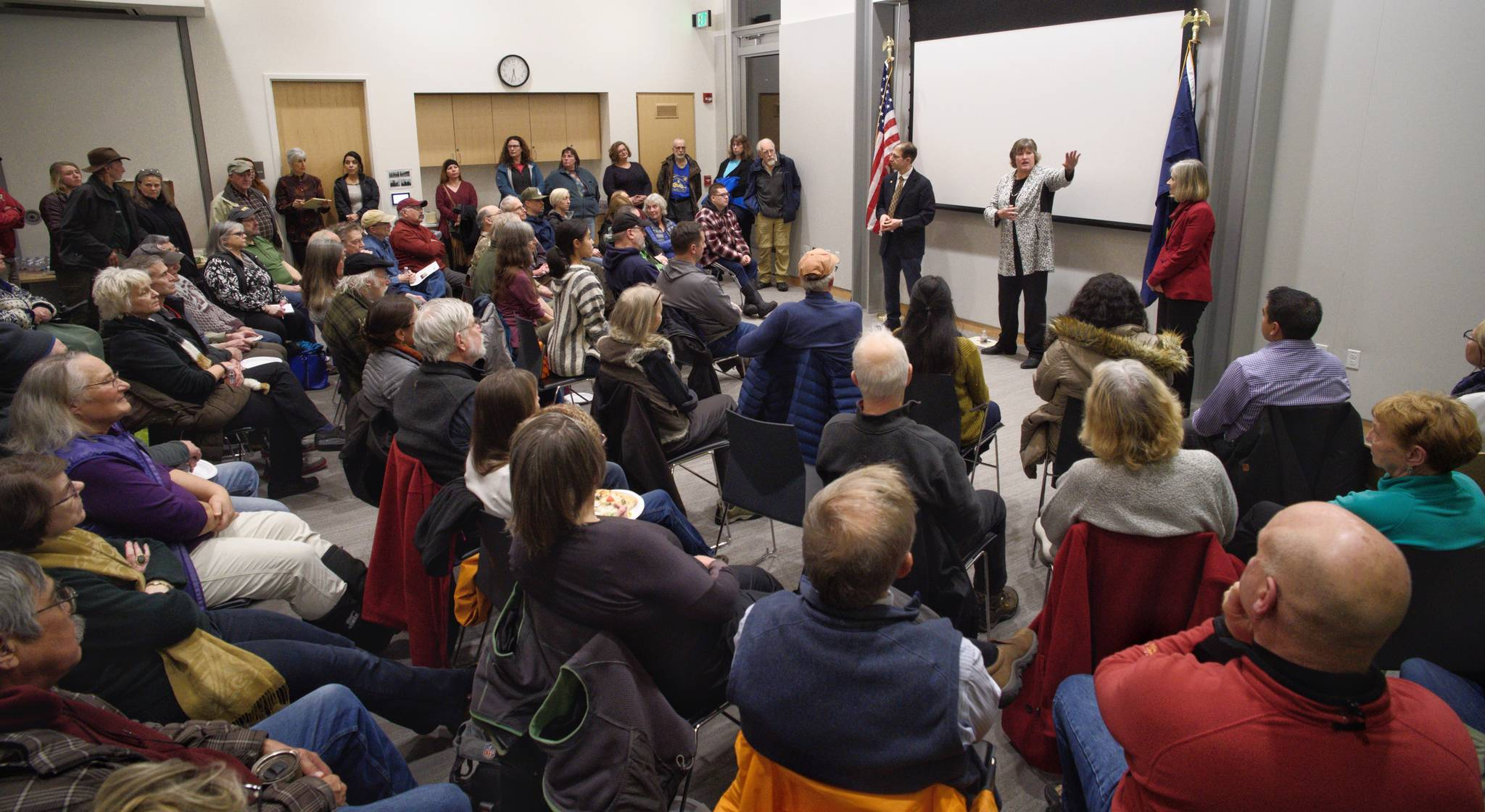 Juneau's legislators, Sen. Jesse Kiehl and Reps. Sara Hannan and Andi Story, talk to a standing room only crowd at a town hall meeting at the Mendenhall Valley Public Library on Tuesday, Jan. 29, 2019. (Michael Penn | Juneau Empire)