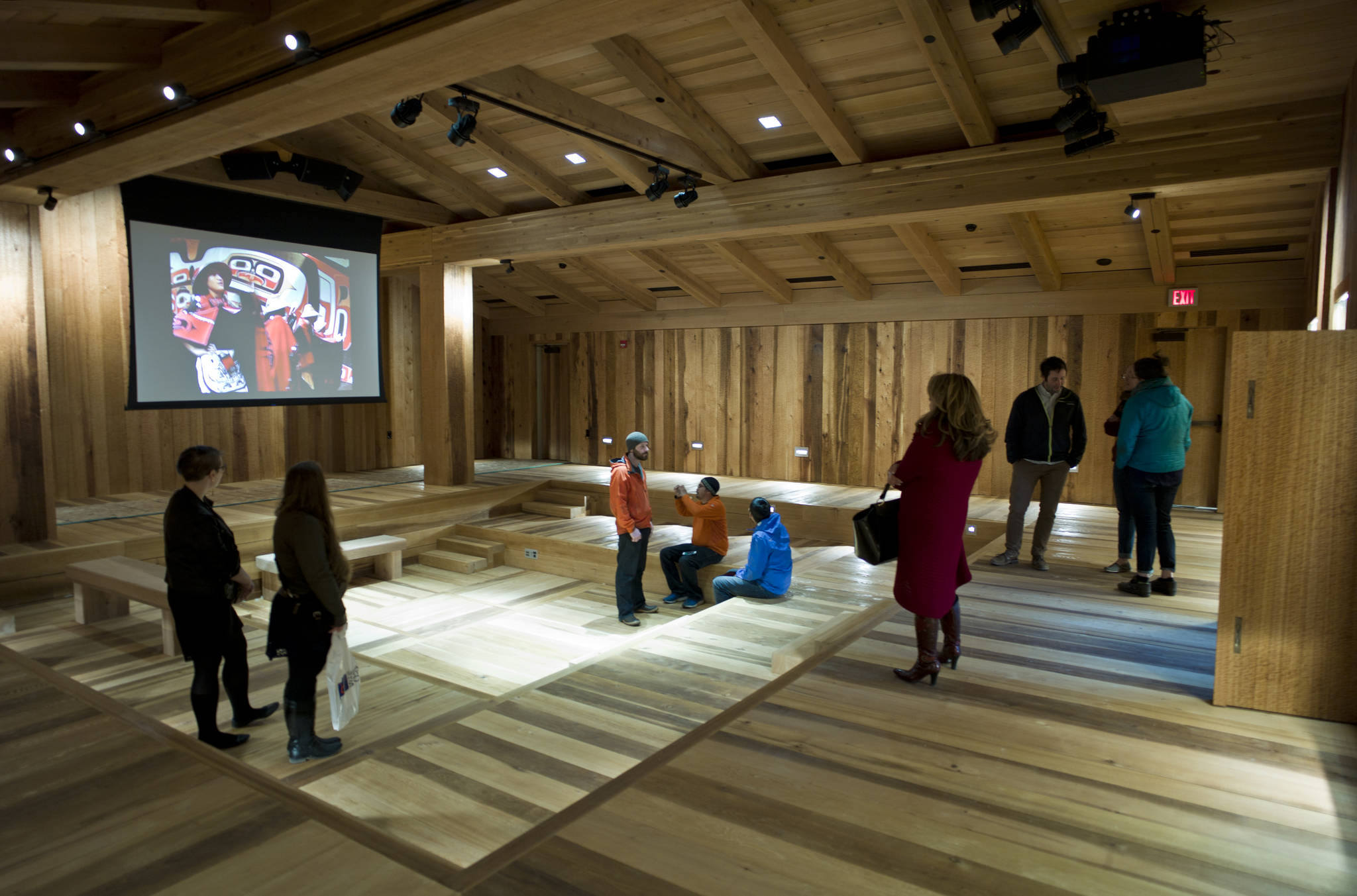 Guests view the Clan House inside the new Walter Soboleff Center and home of the Sealaska Heritage Institute during a Sneak Peak event held on Thursday. (Michael Penn | Juneau Empire File)