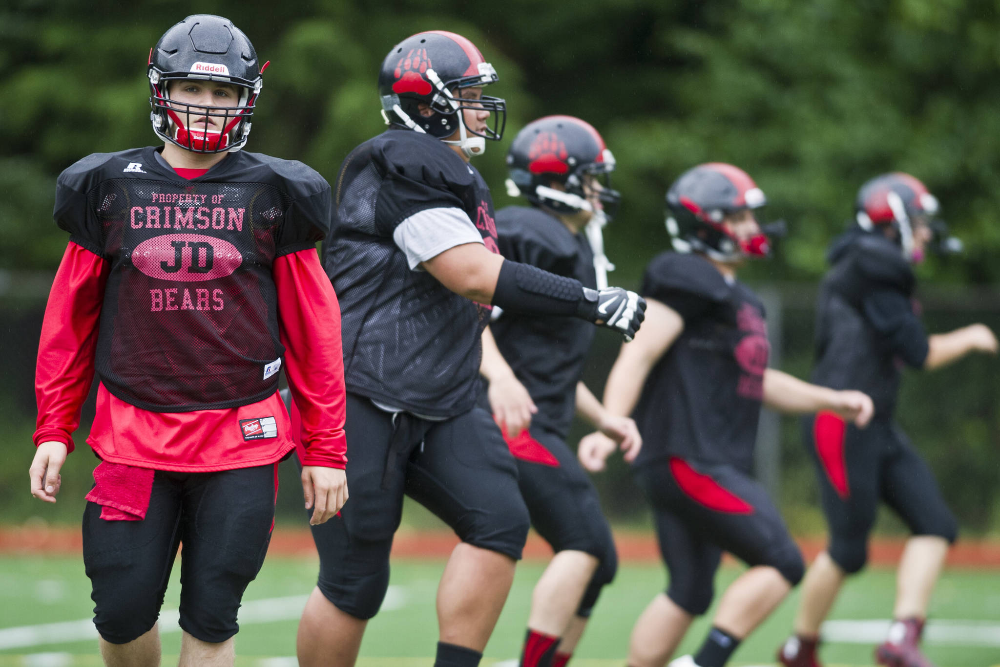 Hunter Hickok leads warmup drills during Juneau-Douglas High School varsity football practice in August of 2015. Hickok was twice named Southeast Conference Defensive Player Of The Year during his time with the Crimson Bears from 2012-2015. (Michael Penn | Juneau Empire File)