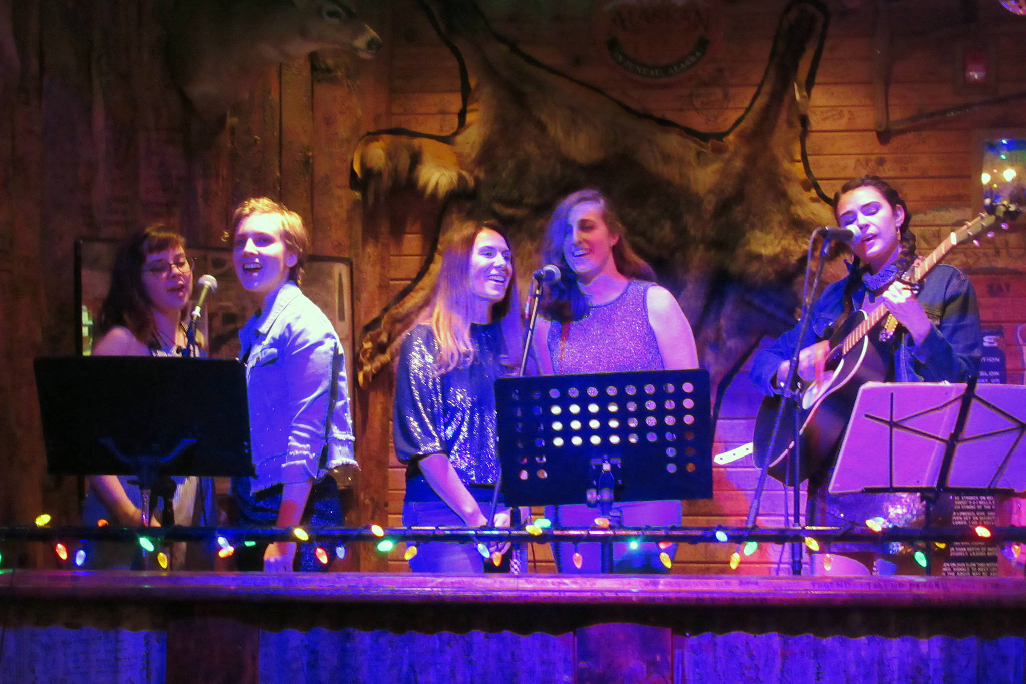 Five of the seven Sand Witches Duras Ruggles, Heather Mountcastle, Brandee Gerke, Zoe Grueskin and Annie Bartholomew perform Friday, Jan. 4, 2019 at the Red Dog Saloon. (Ben Hohenstatt   Capital City Weekly)