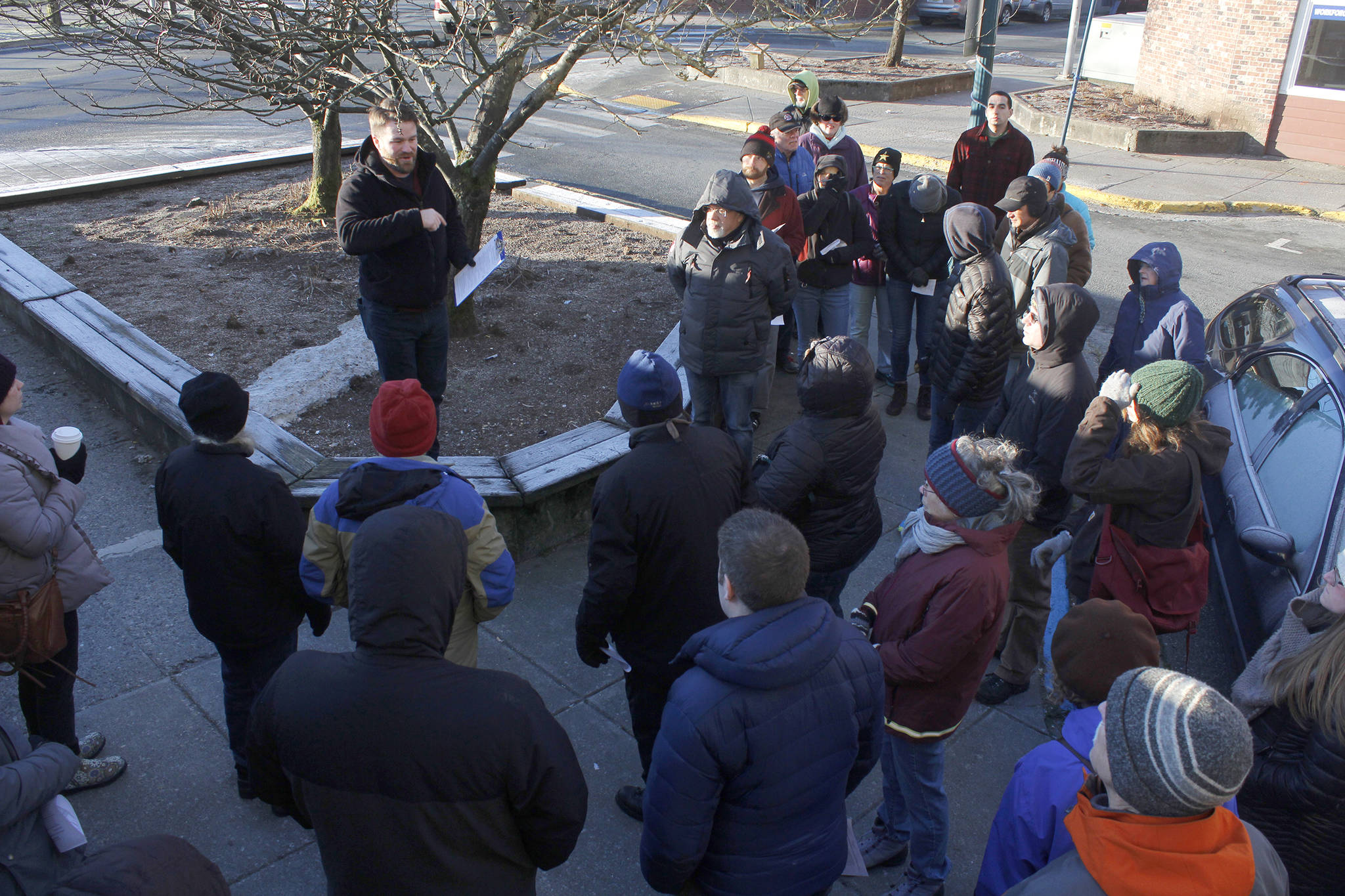 Zane Jones from MRV Architects speaks to attendees at a Blueprint Downtown walking tour on Saturday. Attendees shared their thoughts and experiences about downtown business, housing and public safety. (Alex McCarthy | Juneau Empire)