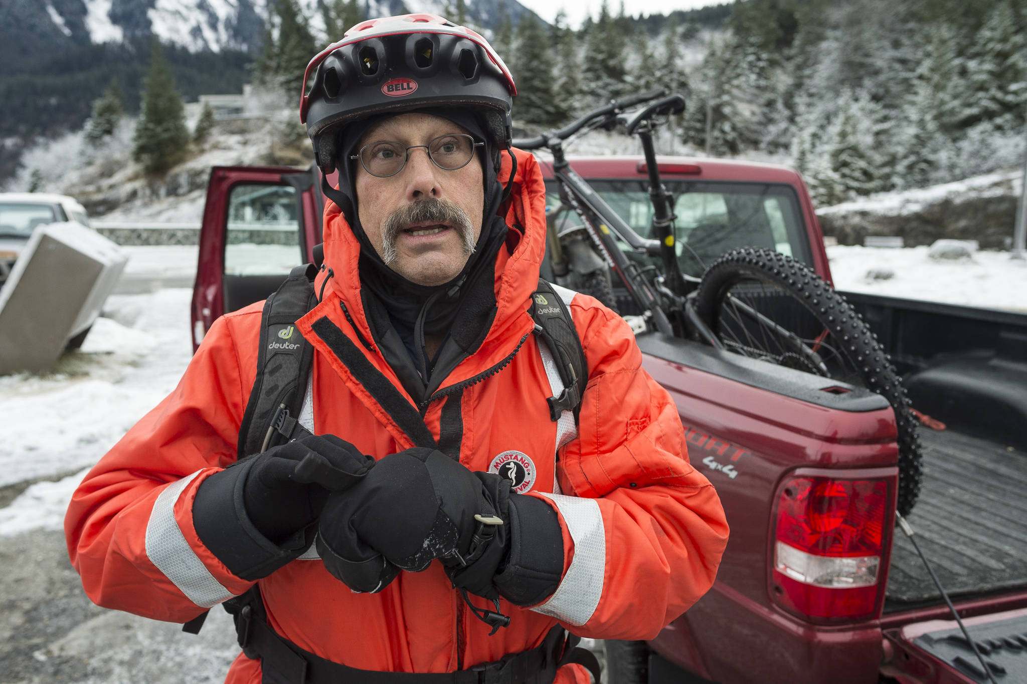 """Bob Funk retells his story on Monday, Jan. 7, 2019, of falling through thin ice while riding his bicycle on Mendenhall Lake near the face of the Mendenhall Glacier on Sunday. He was rescued by a skater who was carrying a throw rope. Funk said, """"I went in and I think adrenaline took care of the first initial cold impact. I was busy working to get up on the ice and when I would it would break out from under me. I don't know if I had enough in the tank to get myself out."""" (Michael Penn 