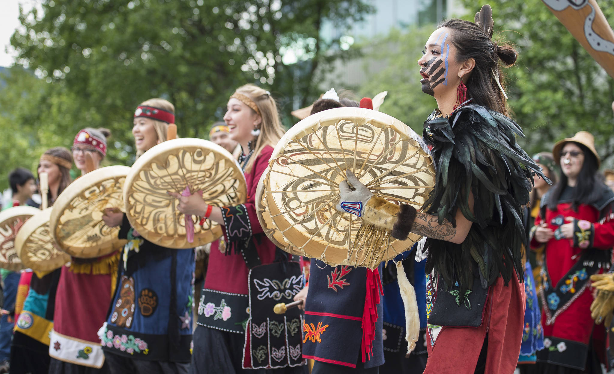 Members of the Mount Saint Elias Dancers of Yakutat parade in the Grand Entrance for Celebration 2018 along Willoughby Avenue on Wednesday, June 6, 2018. (Michael Penn | Juneau Empire)