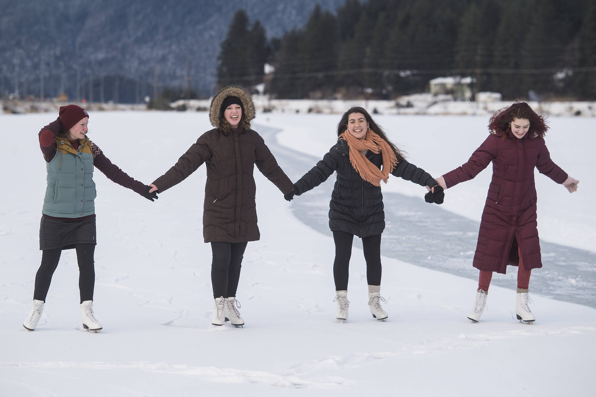 Elizabeth Ramseth, left, Bethany Bibb, Maria Jsustartari and Lydia Smith, right, take time out during the lunch hour to skate at Twin Lakes on Wednesday, Jan. 8, 2019. (Michael Penn | Juneau Empire)