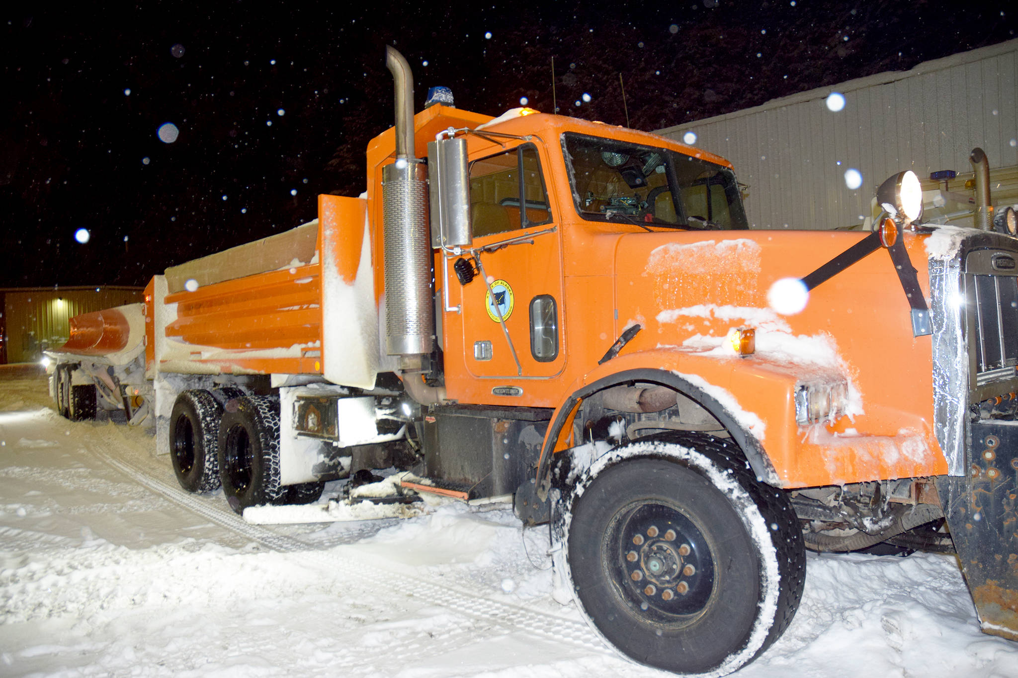 The Department of Transportation and Public Facilities tow plow sits in a parking lot between shifts on Thursday Jan. 10. (Mollie Barnes | Juneau Empire)