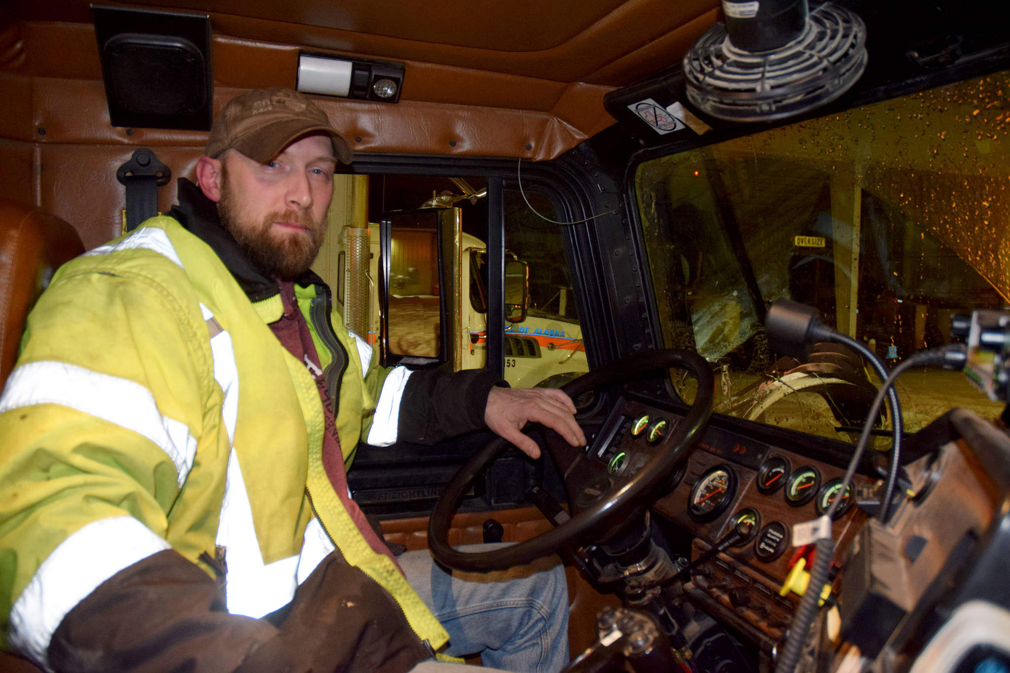 Department of Transportation & Public Facilities Systems Operator Spencer Gates drives a tow plow on Thursday Jan. 10. (Mollie Barnes | Juneau Empire)
