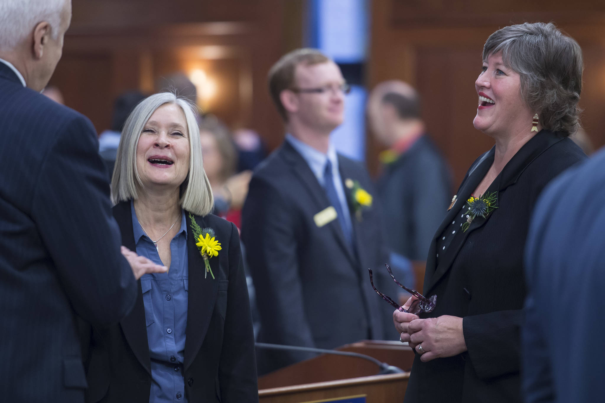 Rep. Andi Story, D-Juneau, center, and Rep. Sara Hannan, D-Juneau, share a laugh with Rep. Bart LeBon, R-Fairbanks, on the opening day of the 31st Session of the Alaska Legislature on Tuesday, Jan. 15, 2019. (Michael Penn | Juneau Empire)
