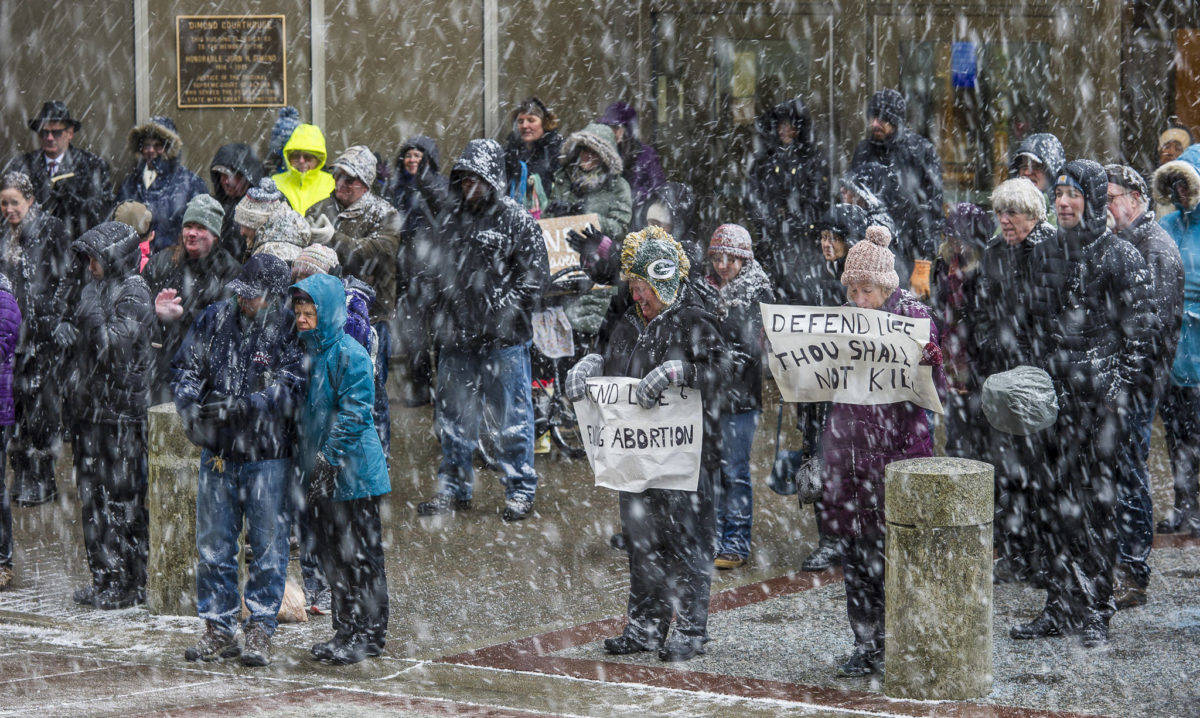 About 100 people attend the Rally for Life last year during a snow squall in front of the Capitol. (Michael Penn | Juneau Empire File)