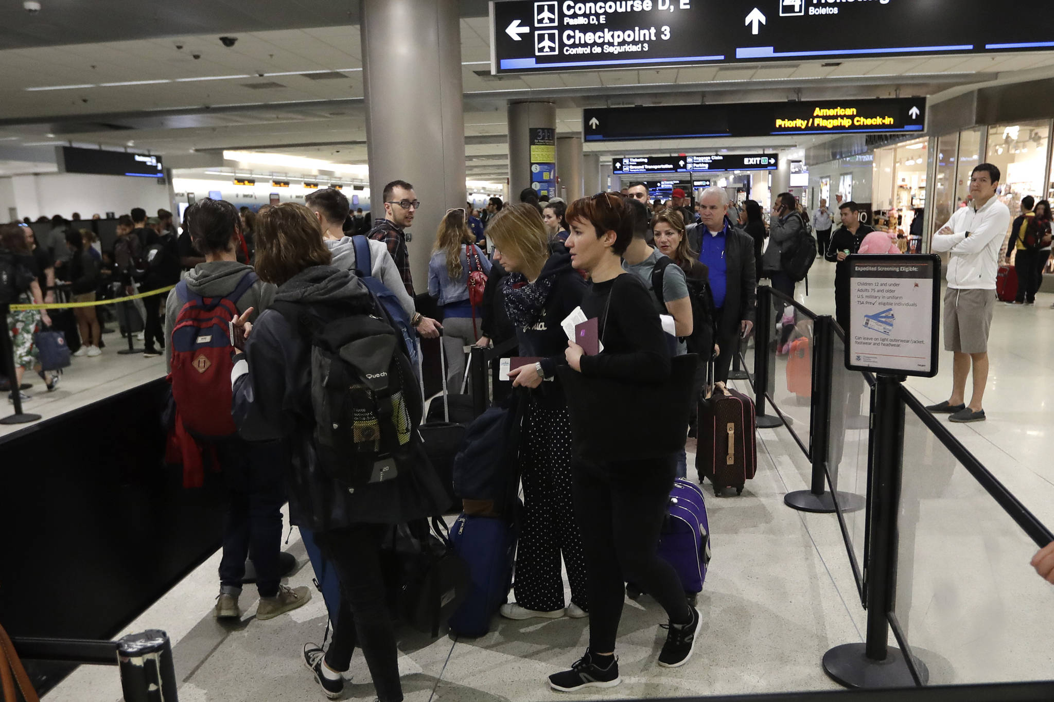 Passengers wait in line at a security checkpoint at Miami International Airport, Friday, Jan. 18, 2019, in Miami. (Lynne Sladky | Associated Press)