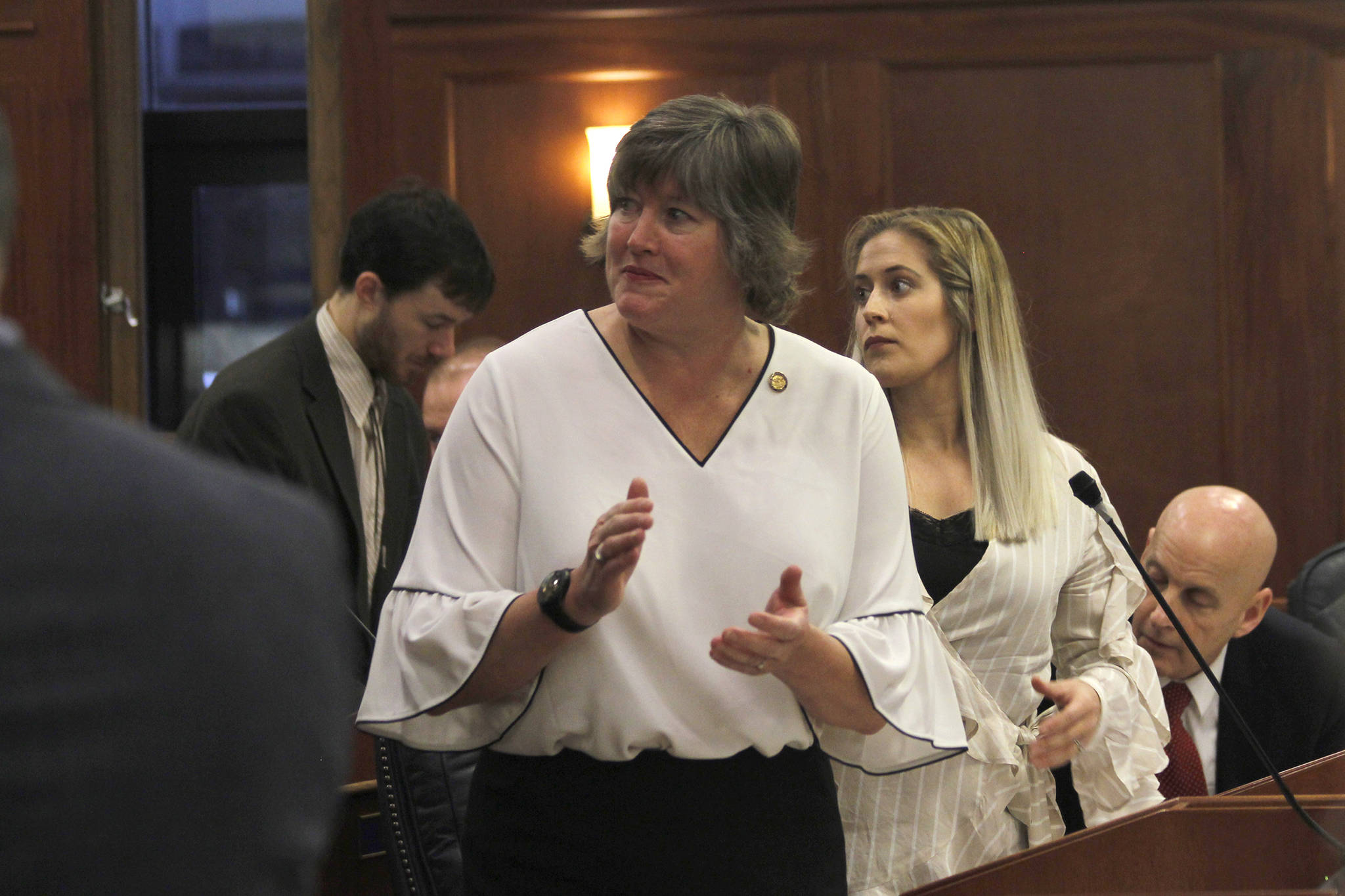 Rep. Sara Hannan, D-Juneau, claps as she introduces a guest during a House of Representatives floor session on Tuesday. (Alex McCarthy | Juneau Empire)
