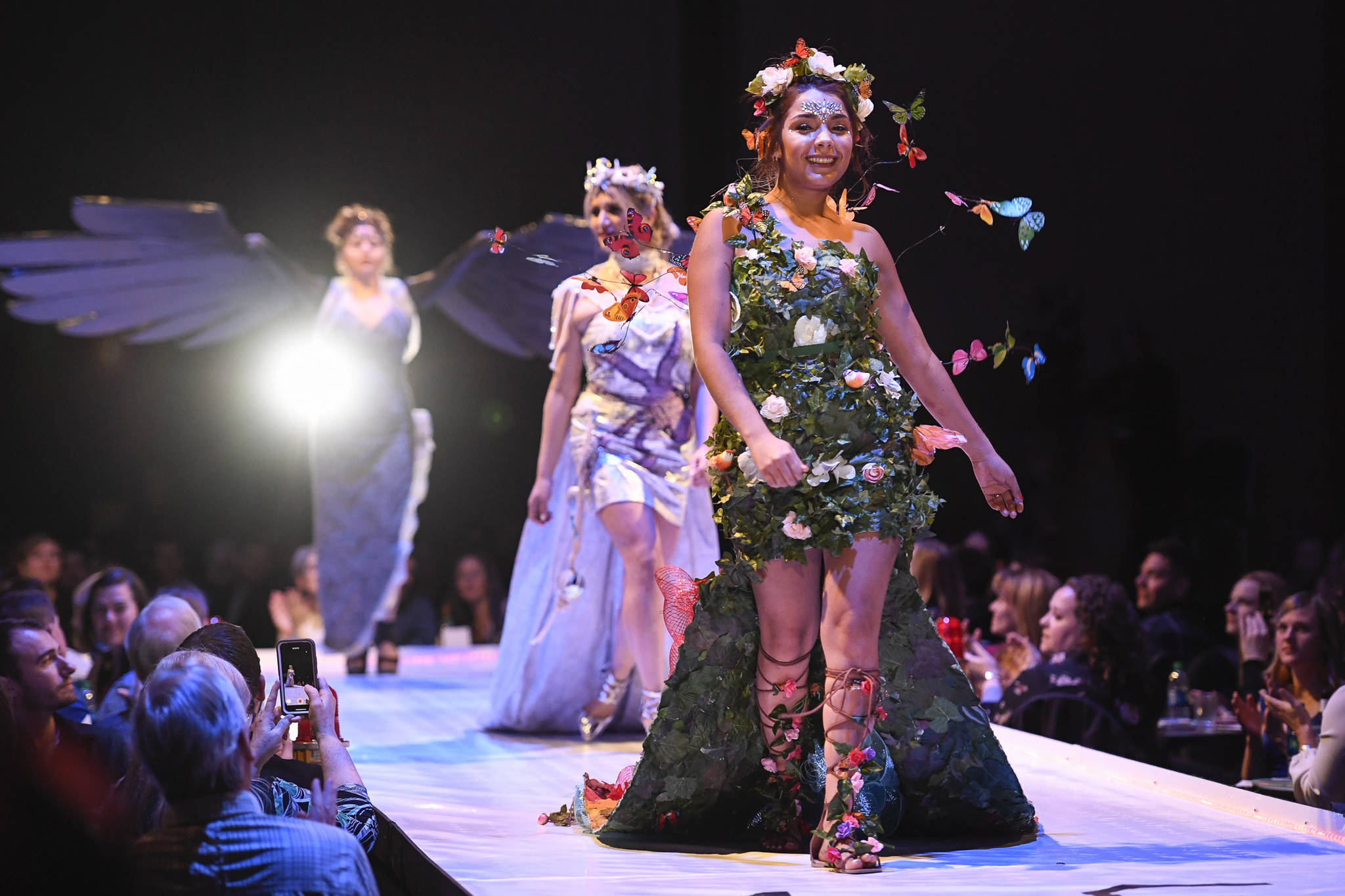 """Maleny Villagomez, Samantha Harrison and Tesa Castillo work the runway with the piece """"Protect What is Sacred"""" at the Wearable Art show at Centennial Hall on Saturday, Feb. 16, 2019. The artists are Paty Villagomez and Glo Ramirez. (Michael Penn 