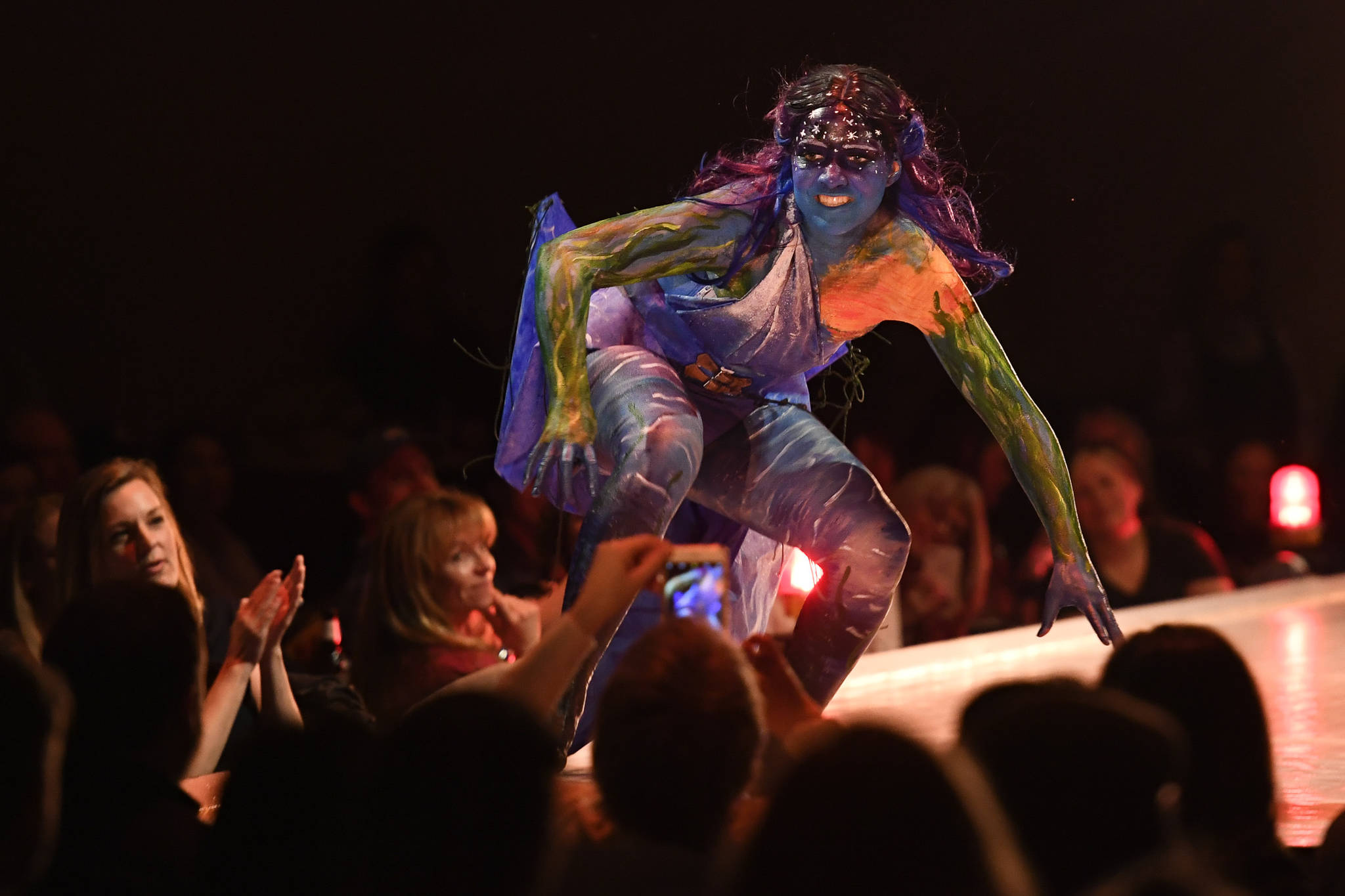 """Clare Boily bring her and Hal Turman's """"The Siren"""" to life at the Wearable Art show at Centennial Hall on Saturday, Feb. 16, 2019. (Michael Penn 