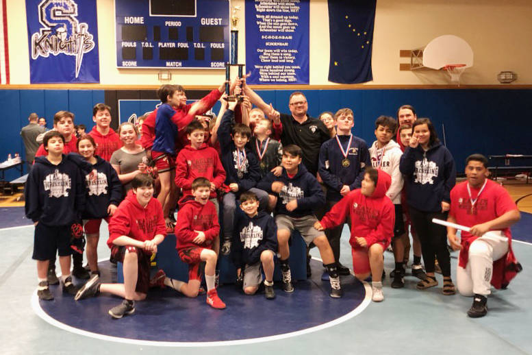 The Floyd Dryden Middle School wrestling team celebrates its Southeast Tournament championship on Saturday at Schoenbar Middle School in Ketchikan. (Courtesy Photo | Ken Brown)