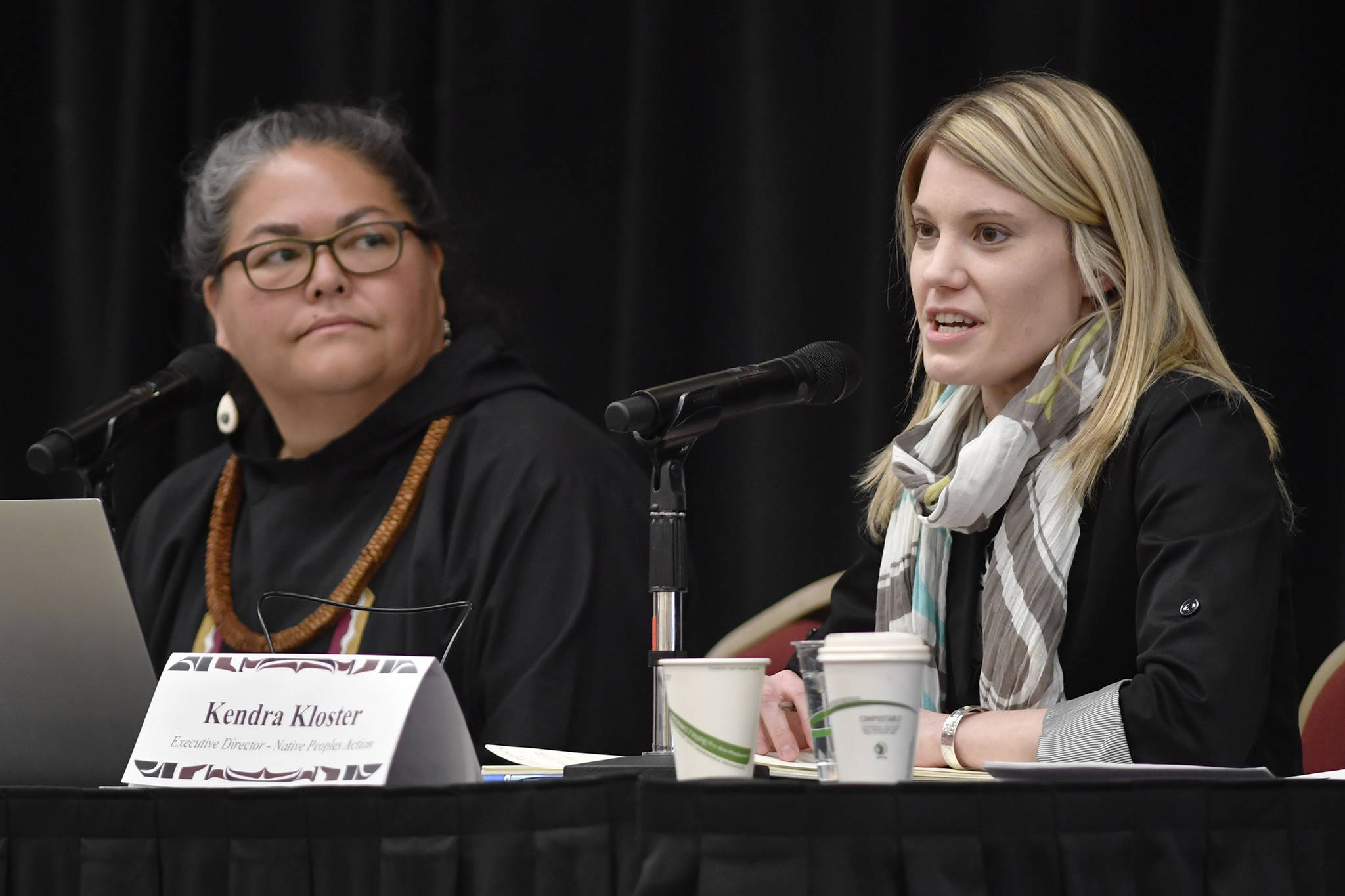 Kendra Kloster, executive director of the Native Poples Action, right, and Liz Medicine Crow, President and CEO of the Alaska Native Policy Center, speak at the Native Issues Forum at Elizabeth Peratrovich Hall on Wednesday, Feb. 20, 2019. (Michael Penn | Juneau Empire)