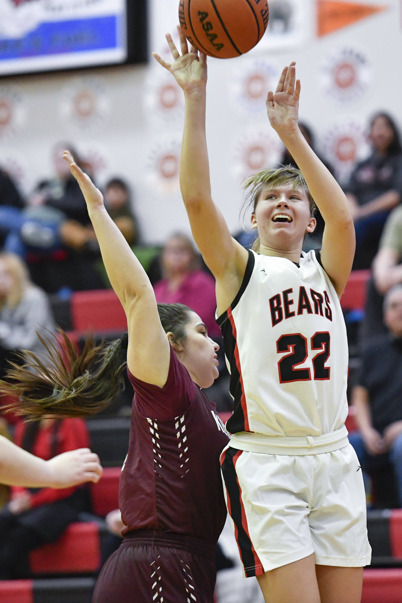 Juneau-Douglas' Caitlin Pusich, right, shoots against Ketchikan's Nadire Zhuta at JDHS on Friday, Feb. 22, 2019. JDHS won 56-38. (Michael Penn | Juneau Empire)