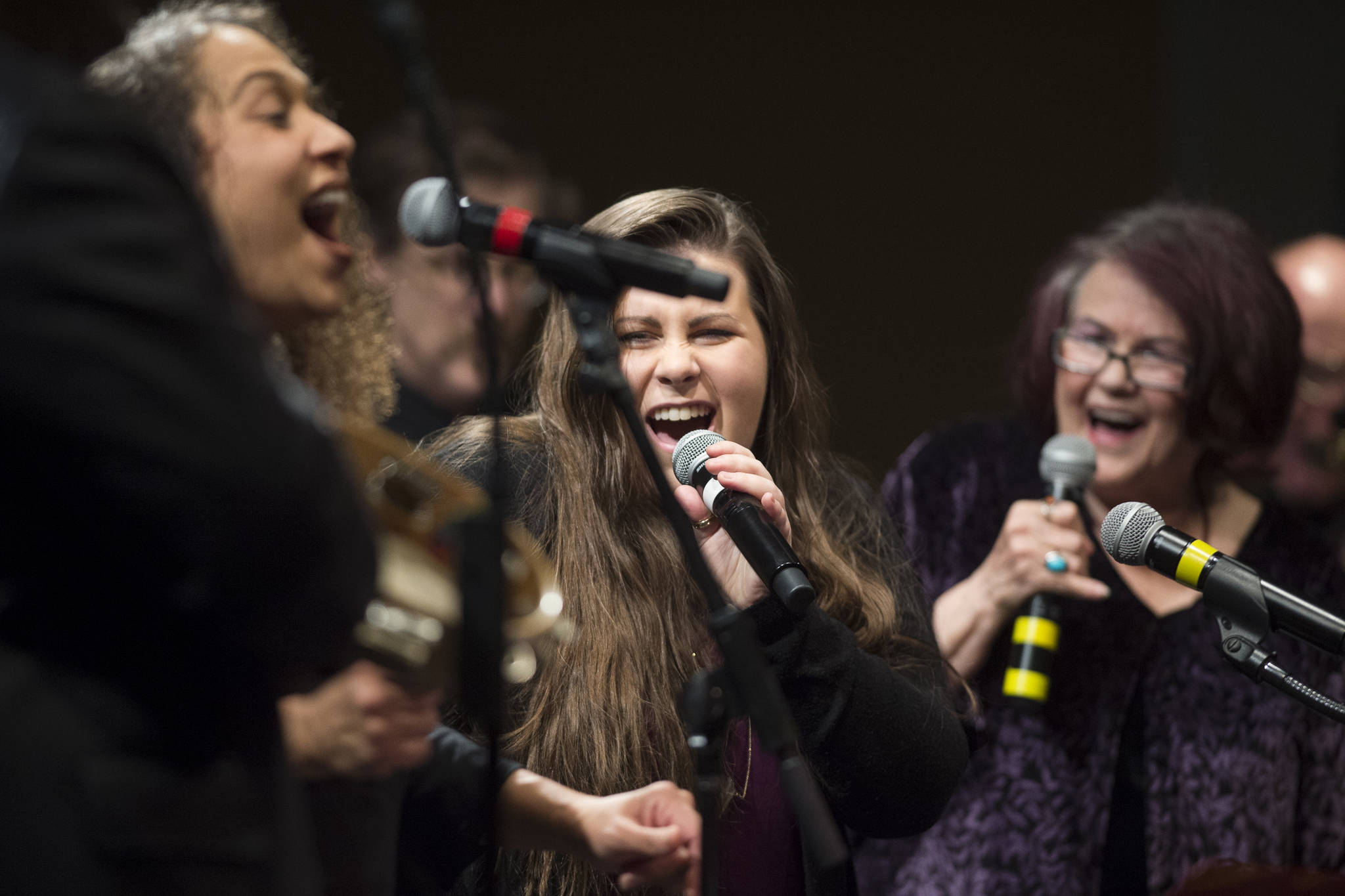 """Alyssa Fischer, center, sings during a performance of """"Motown for Our Town"""" featuring Ryan Shaw, Bobby Lewis, Eustace Johnson, Jaunelle Celaire others at the Juneau Arts & Culture Center on Friday, March 1, 2019. (Michael Penn 