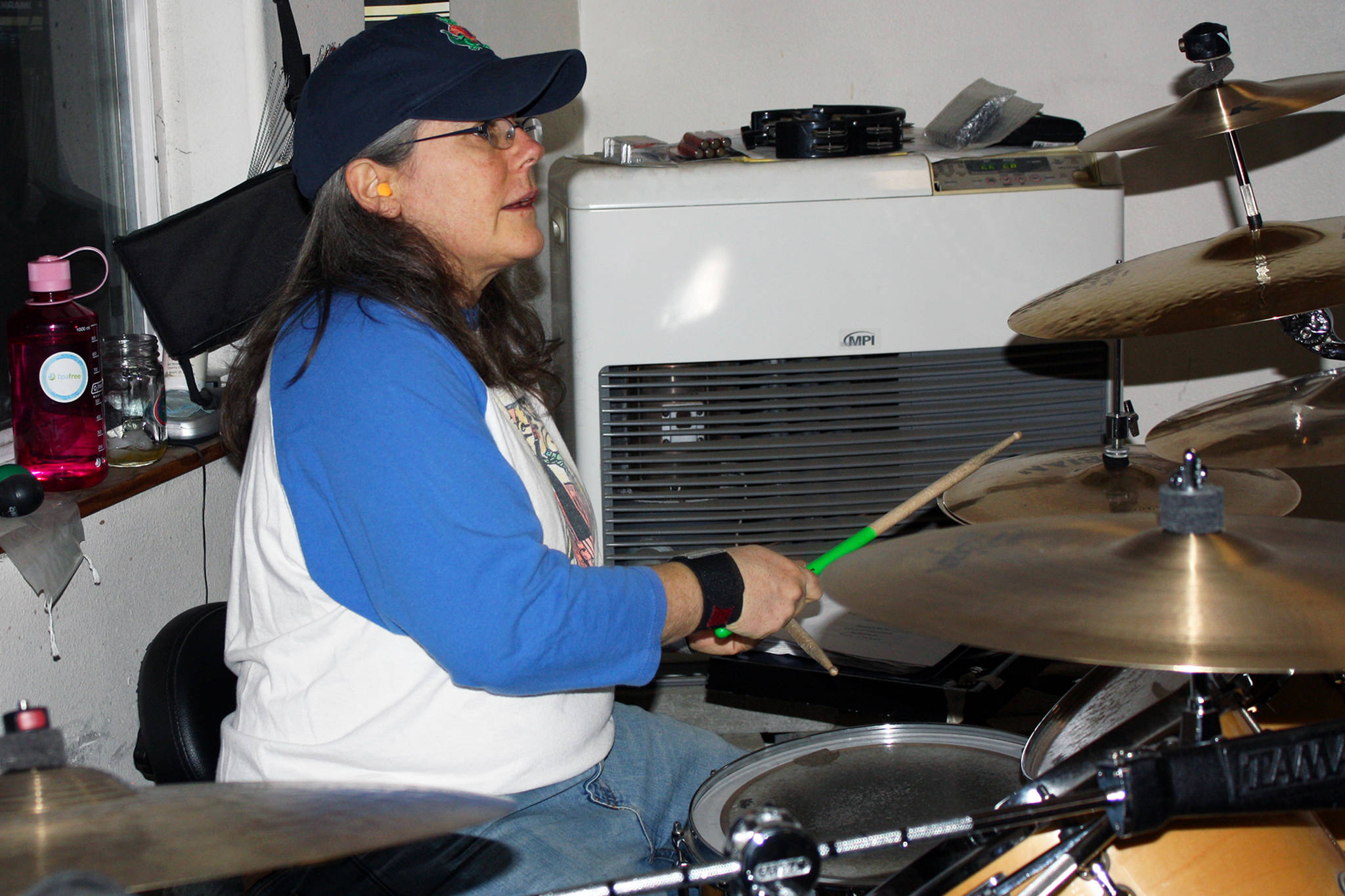 Kelly Henriksen plays drums during a Fire on McGinnis practice Saturday, March 9, 2019. (Ben Hohenstatt | Capital City Weekly)