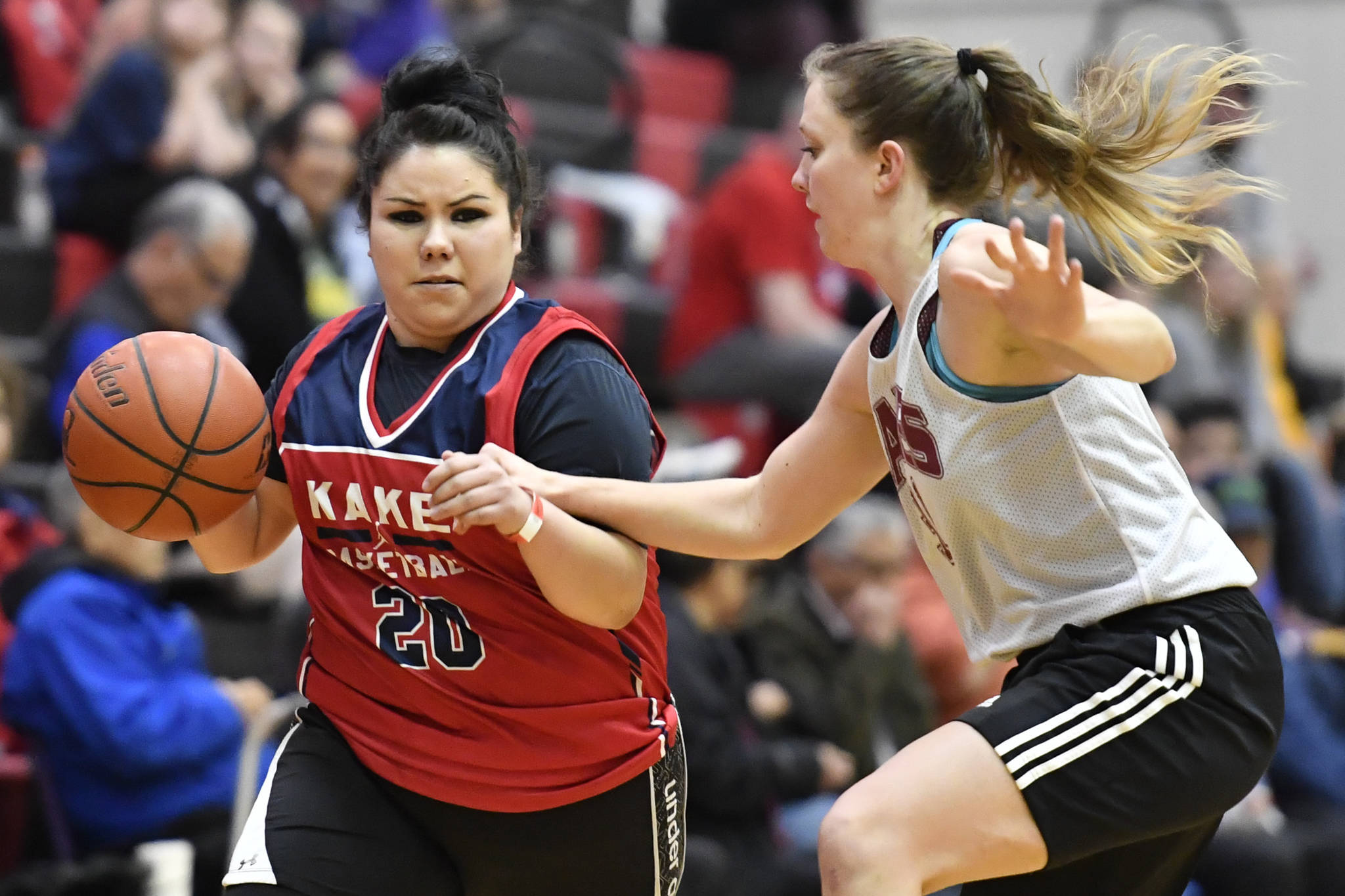 Kake's Monica Ashenfelter, left, drives against Haines' Rachel Brittenham at the Juneau Lions Club 73rd Annual Gold Medal Basketball Tournament at Juneau-Douglas High School: Yadaa.at Kalé on Wednesday, March 20, 2019. Haines won 67-20. (Michael Penn | Juneau Empire)