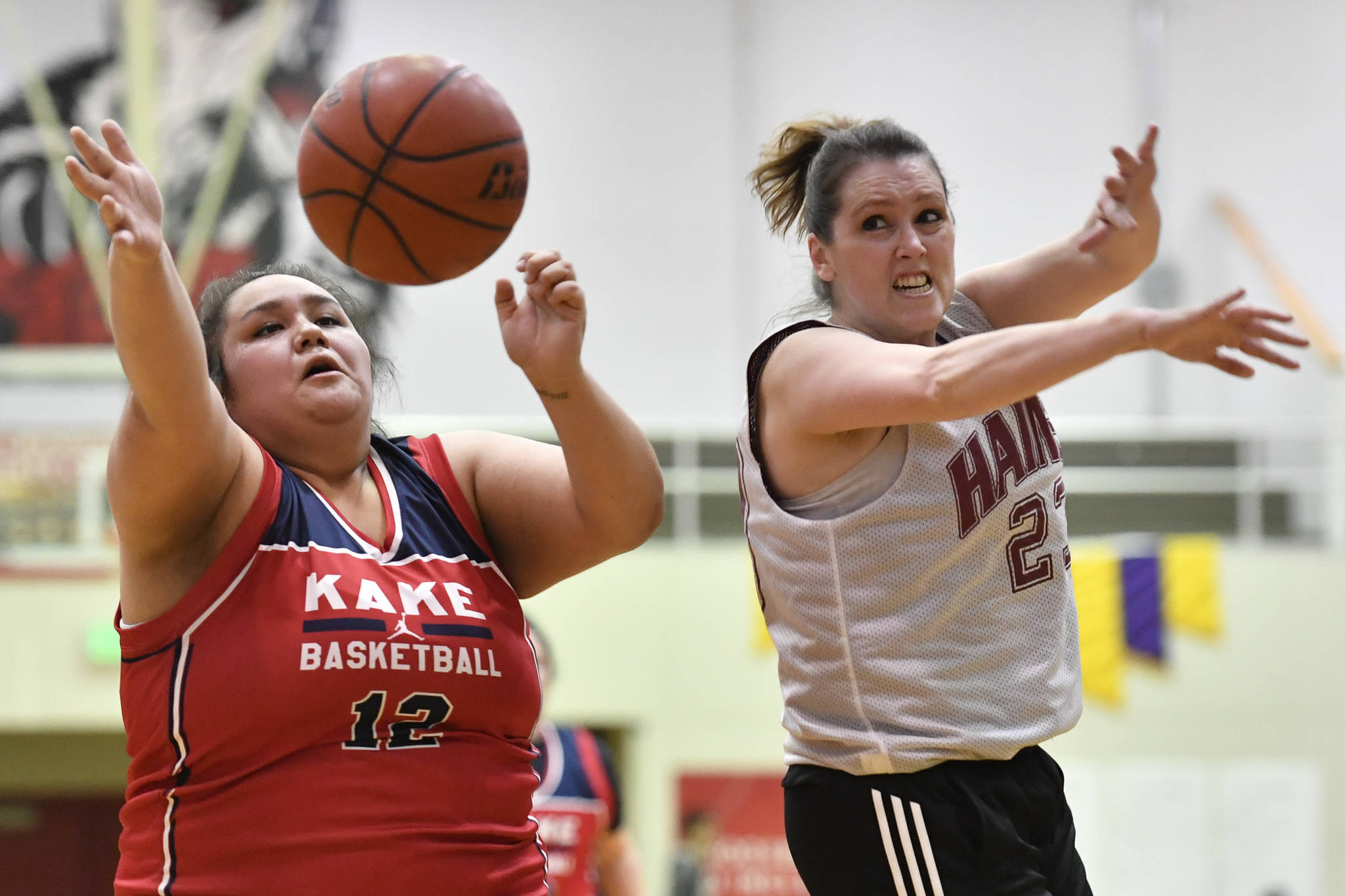 Kake's Sophia Aceveda, left, and Haines' Nicole Holm compete for a rebound at the Juneau Lions Club 73rd Annual Gold Medal Basketball Tournament at Juneau-Douglas High School: Yadaa.at Kalé on Wednesday, March 20, 2019. Haines won 67-20. (Michael Penn | Juneau Empire)