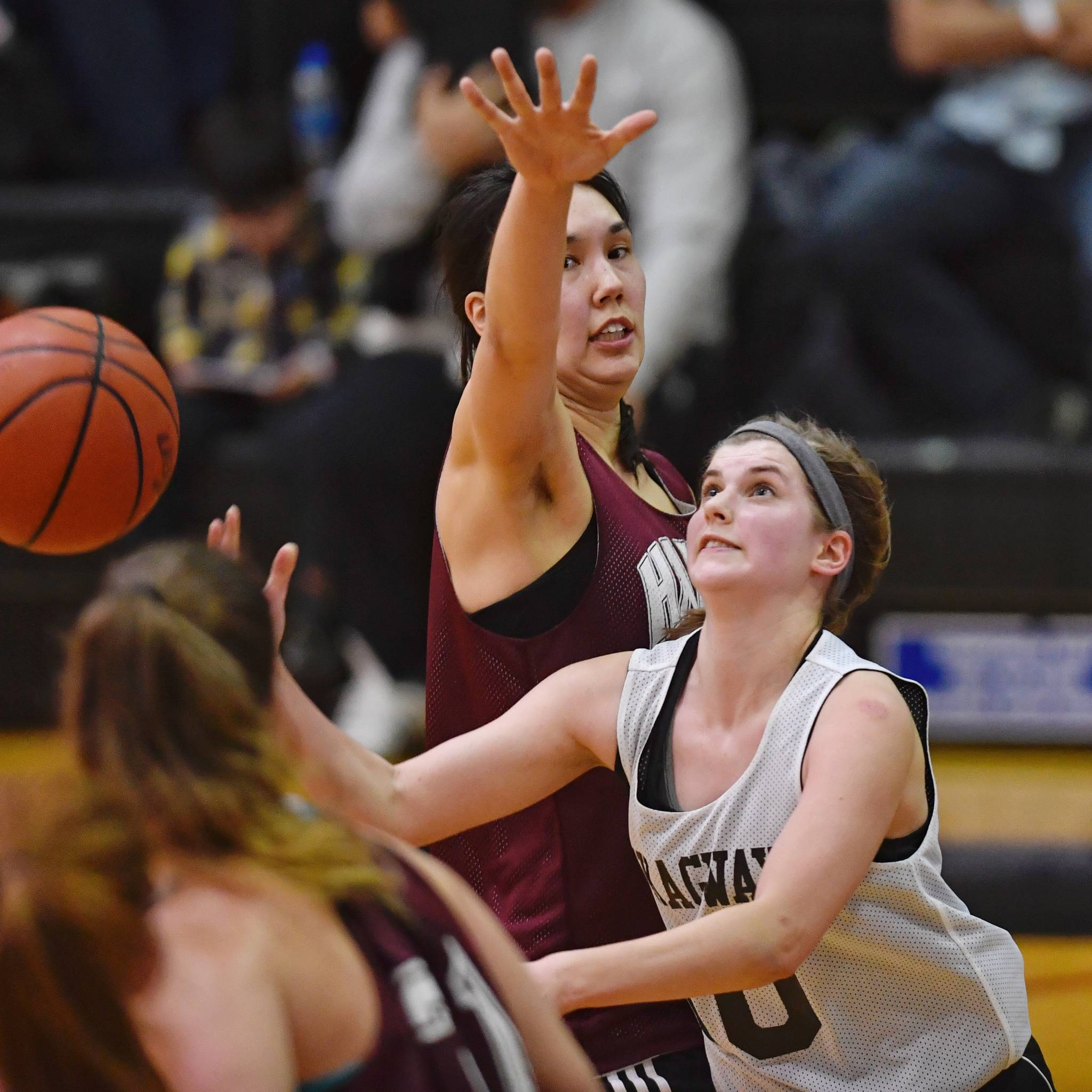 Skagway's Kaylie Smith, right, shoots against Haines' Fran Daly in the women's final at the Gold Medal Basketball Tournament on Saturday, March 23, 2019. (Michael Penn | Juneau Empire)