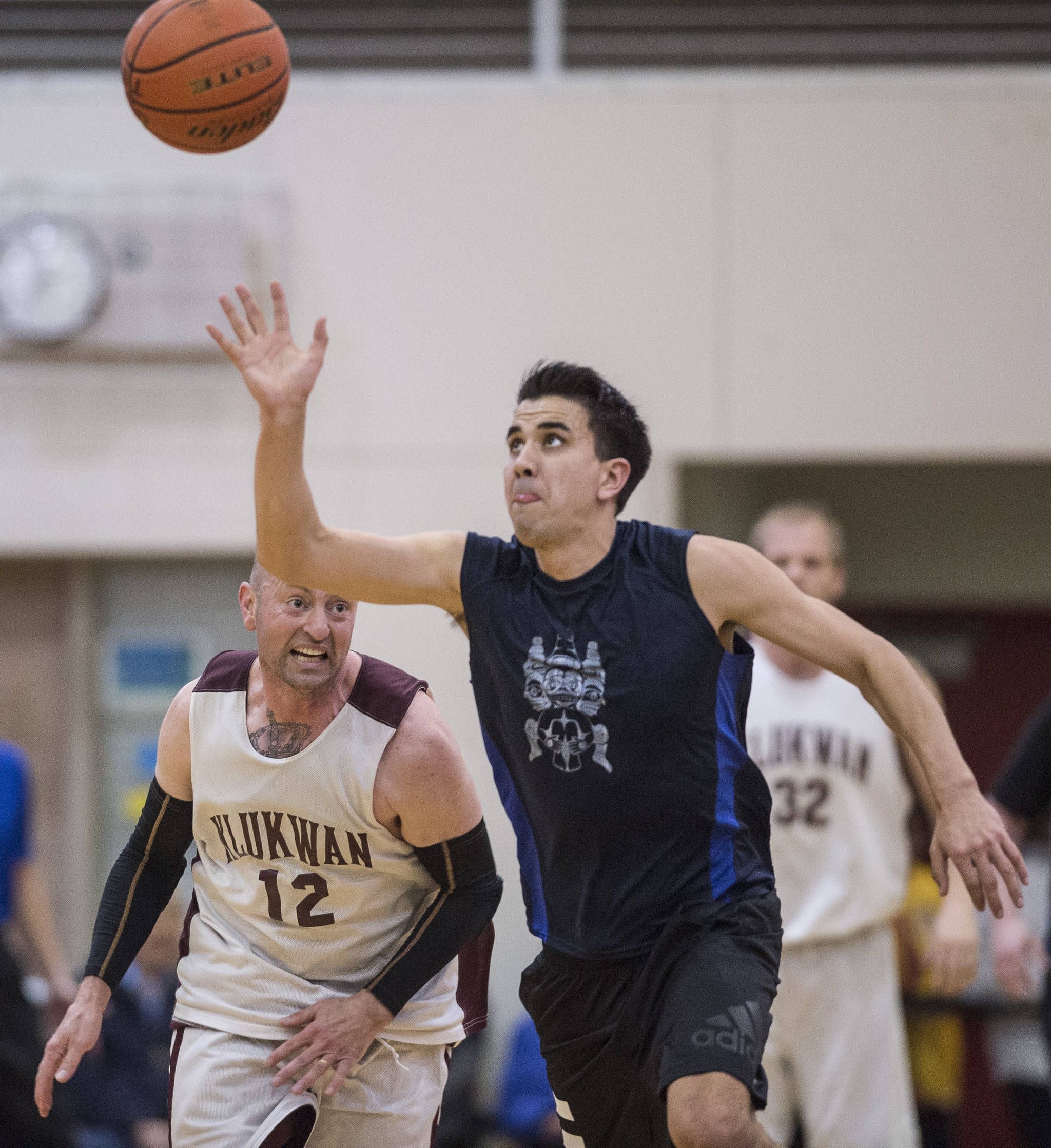 Hydaburg's Ben Young, right, steals the ball from Klukwan's Jason Shull in the C final at the Gold Medal Basketball Tournament on Saturday, March 23, 2019. Hydaburg won 93-81. (Michael Penn | Juneau Empire)