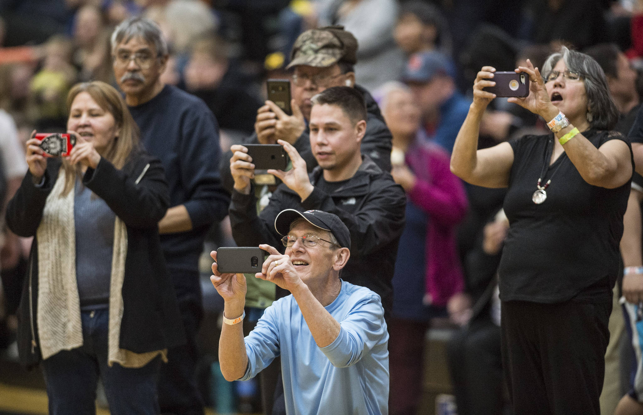 Family and friends photograph the winning Hydaburg team after they beat Klukwan in the C final at the Gold Medal Basketball Tournament on Saturday, March 23, 2019. Hydaburg won 93-81. (Michael Penn | Juneau Empire)
