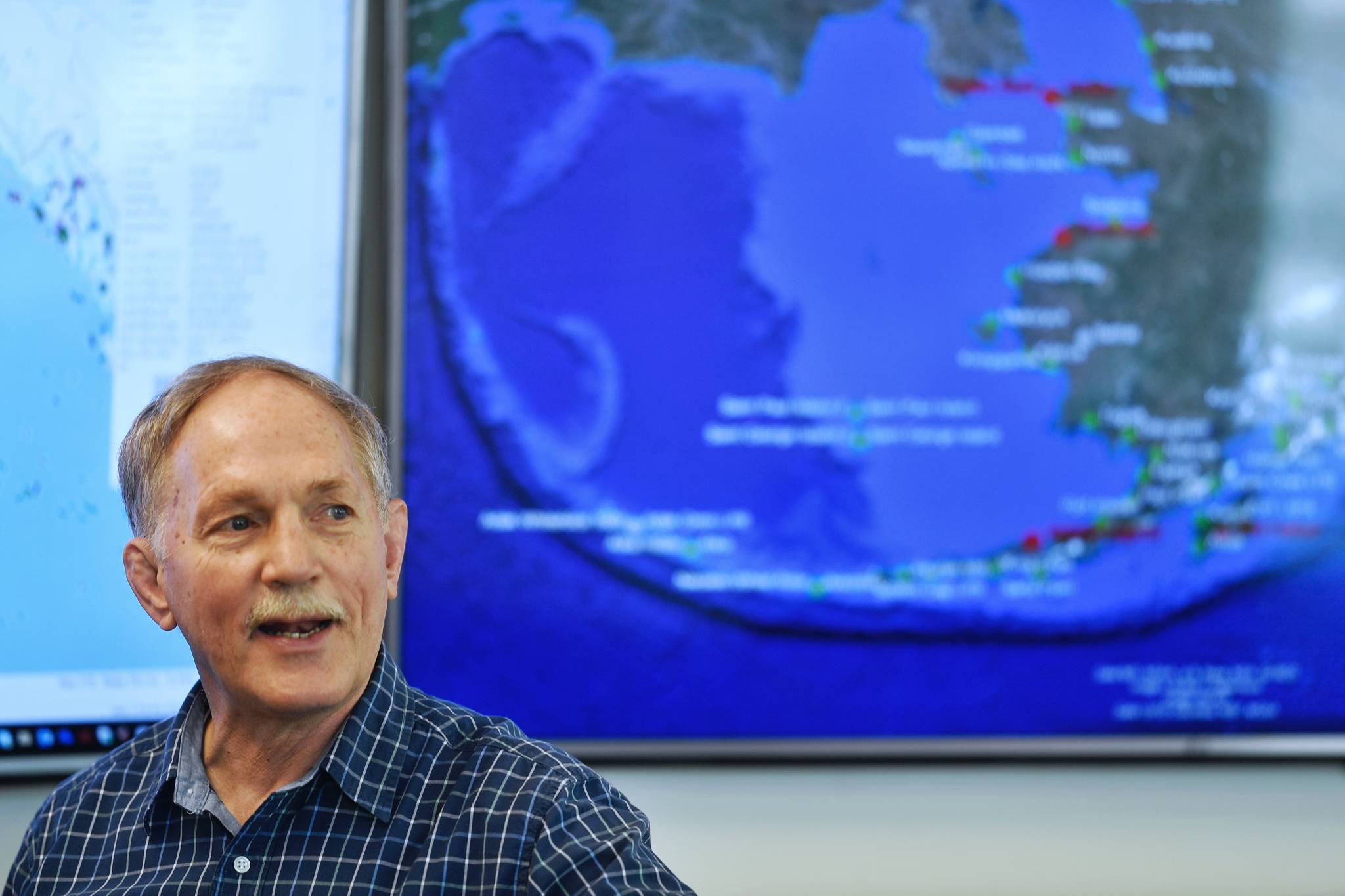 Retired U.S. Coast Guard Captain Ed Page, Executive Director of the Alaska Marine Exchange, explains Wednesday, March 27, 2019, how the exchange came about and how it now keeps track of ships in Alaska waters and beyond. (Michael Penn | Juneau Empire)