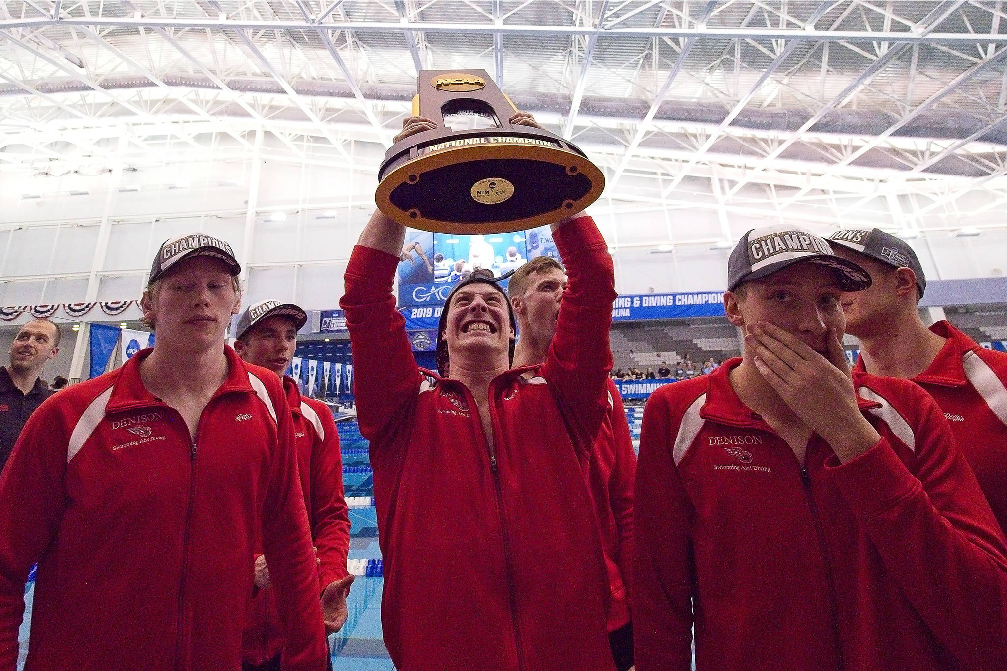 Denison University senior Kenny Fox celebrates his team's national championship at the 2019 NCAA Division III Swimming & Diving Championships at Greensboro Aquatic Center in Greensboro, North Carolina, on Saturday, March 30, 2019. (Courtesy Photo | Linda Striggo)