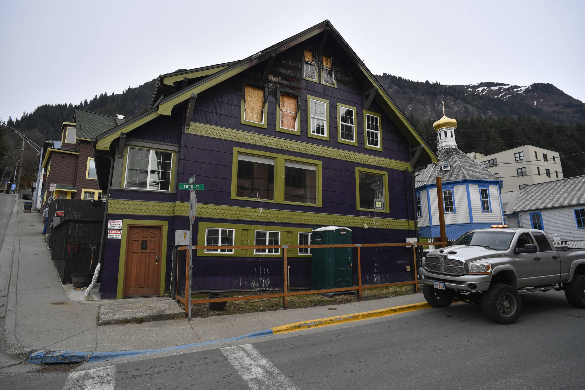 Ernestine Hayes gives a tour of her fire-damaged house at the corner of 5th and Franklin Street on Wednesday, April 3, 2019. (Michael Penn | Juneau Empire)