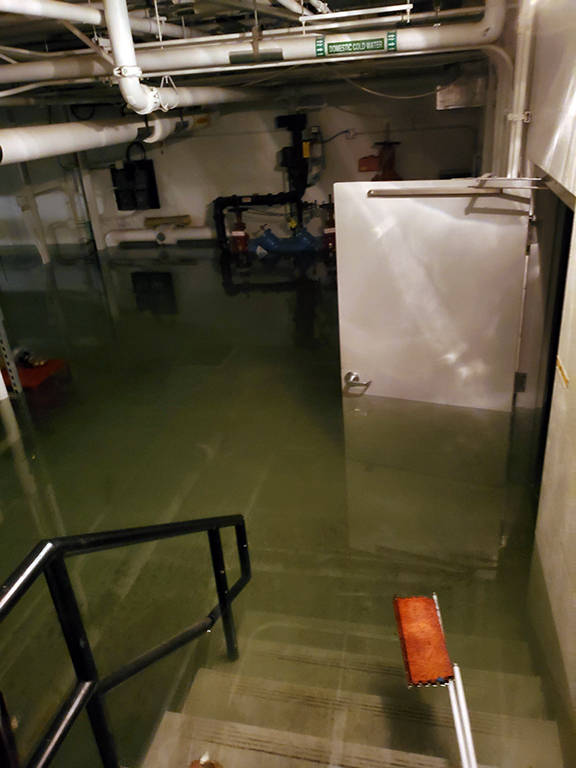 This photo shows flooding in the basement of the Marie Drake building on Friday, April 5, 2019. Flooding in a basement boiler room spread diesel fumes throughout the building.(Courtesy Photo | Chris Cairns)