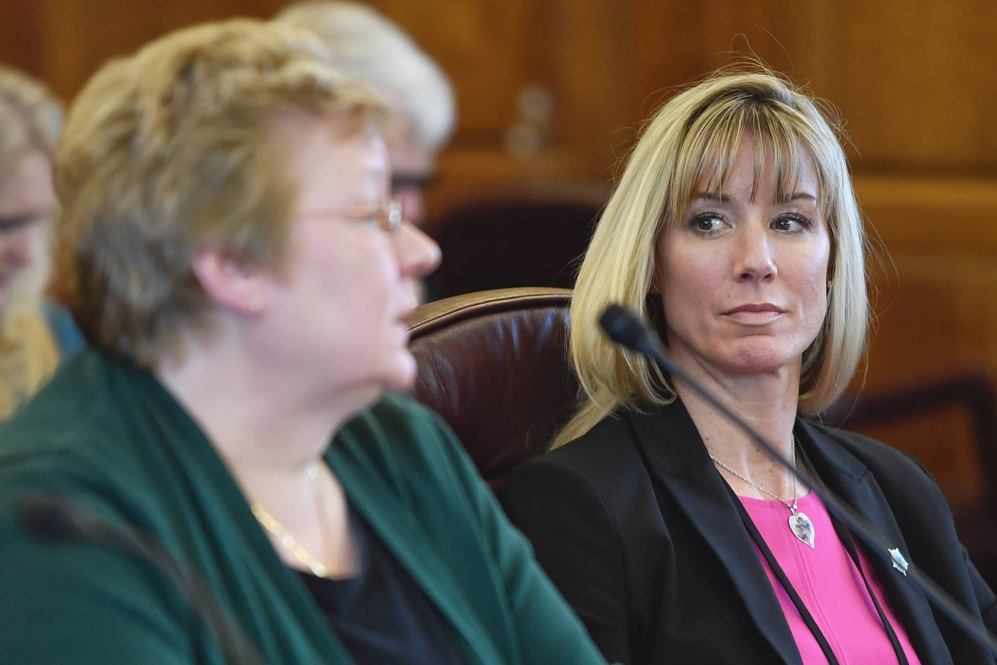 Amanda Price, commissioner of the Department of Public Safety, right, watches as Kathryn Monfreda, bureau chief of the Department of Public Safety's Division of Statewide Services, presents the Uniform Crime Reporting Annual Report to House members during an informational meeting at the Capitol on Tuesday, Feb. 5, 2019. (Michael Penn | Juneau Empire File)