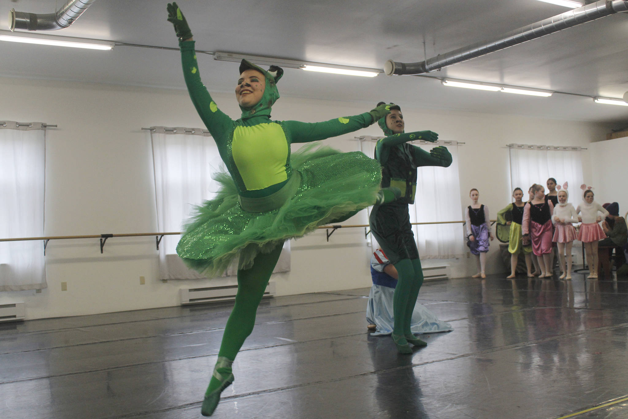 "Dancer Elin Antaya, portraying a frog, dances during a rehearsal for Juneau Dance Theatre's production of ""Snow White"" at Juneau Dance Theatre on Saturday, April 20, 2019. (Alex McCarthy 