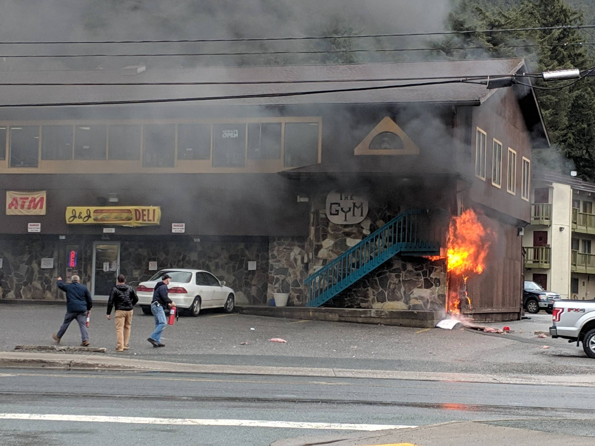The building that houses The Gym, J&J Deli and more was the site of fire Monday, April 22, 2019. No one was harmed in the fire. Before Capital City Fire/Rescue arrived Alaska Electric Light & Power workers used fire extinguishers to help control the fire. (Ben Hohenstatt | Juneau Empire)