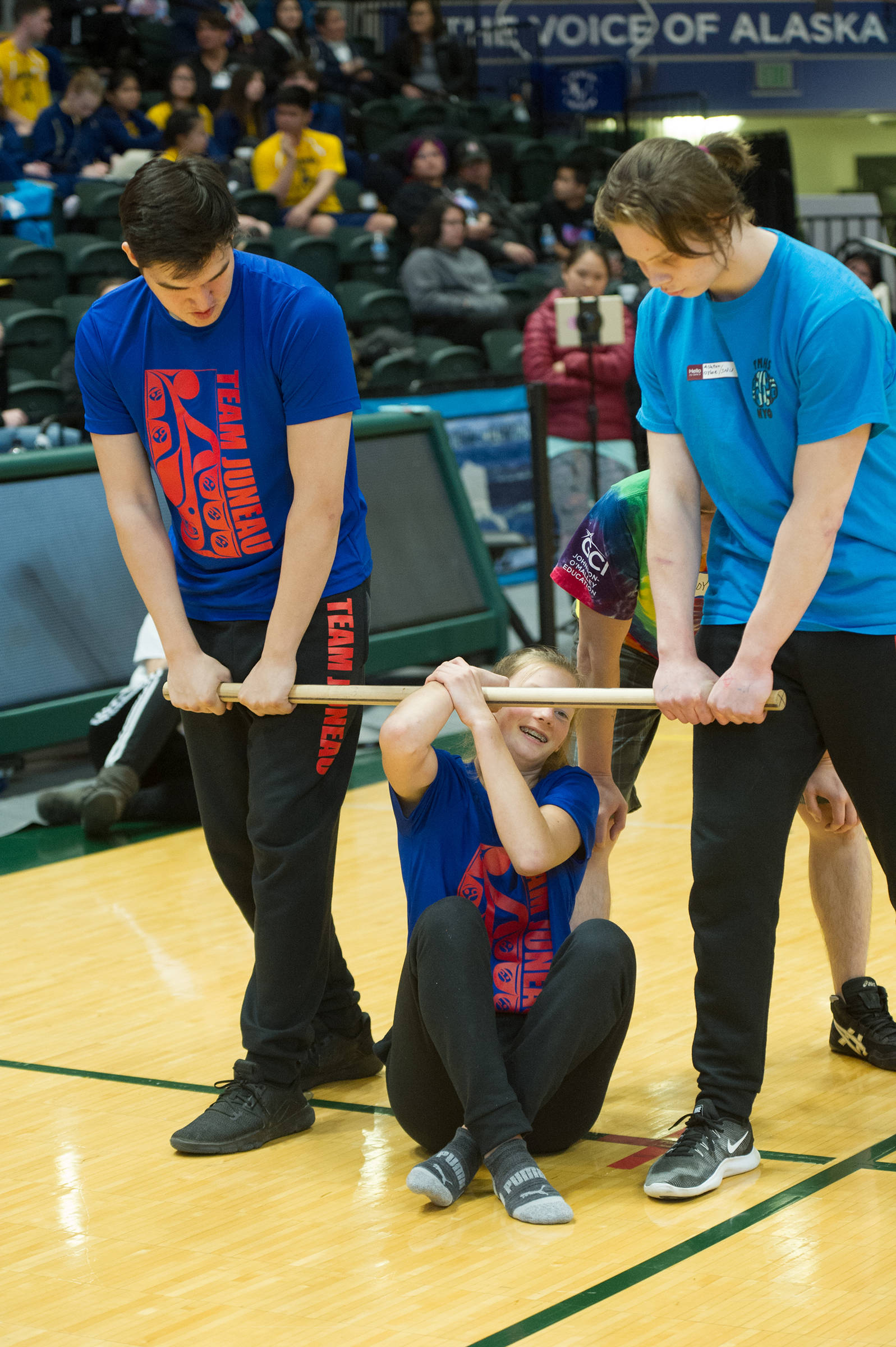 Skylar Tuckwood gets ready to be carried by Ashton Olyloe and Josh Sheakley in the wrist carry at the 2019 NYO Games at the Alaska Airlines Center in Anchorage, Alaska, on Thursday, April 25, 2019. (Michael Dinneen | For the Juneau Empire)