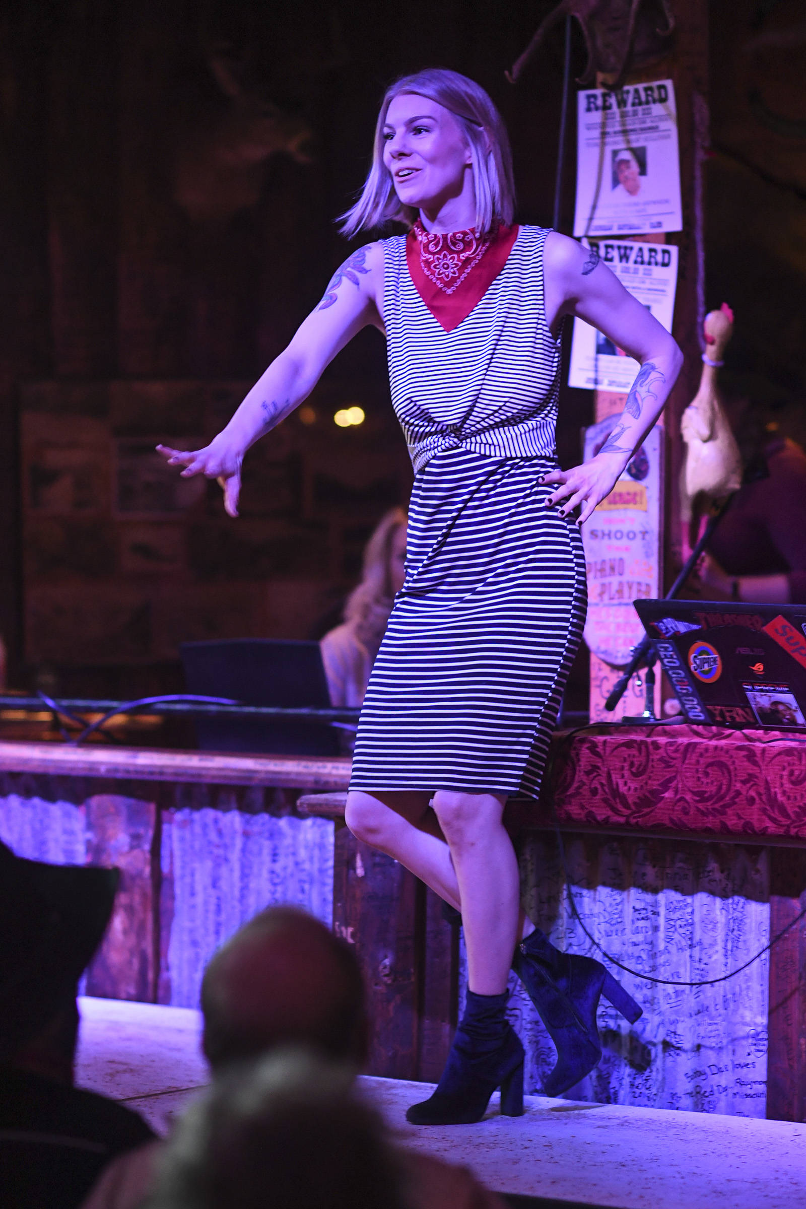 Women's clothing from The Studio is modeled on stage during the Juneau Rotaract's Wild West Roundup Fashion Show at the Red Dog Saloon on Saturday, April 27, 2019. (Michael Penn | Juneau Empire)