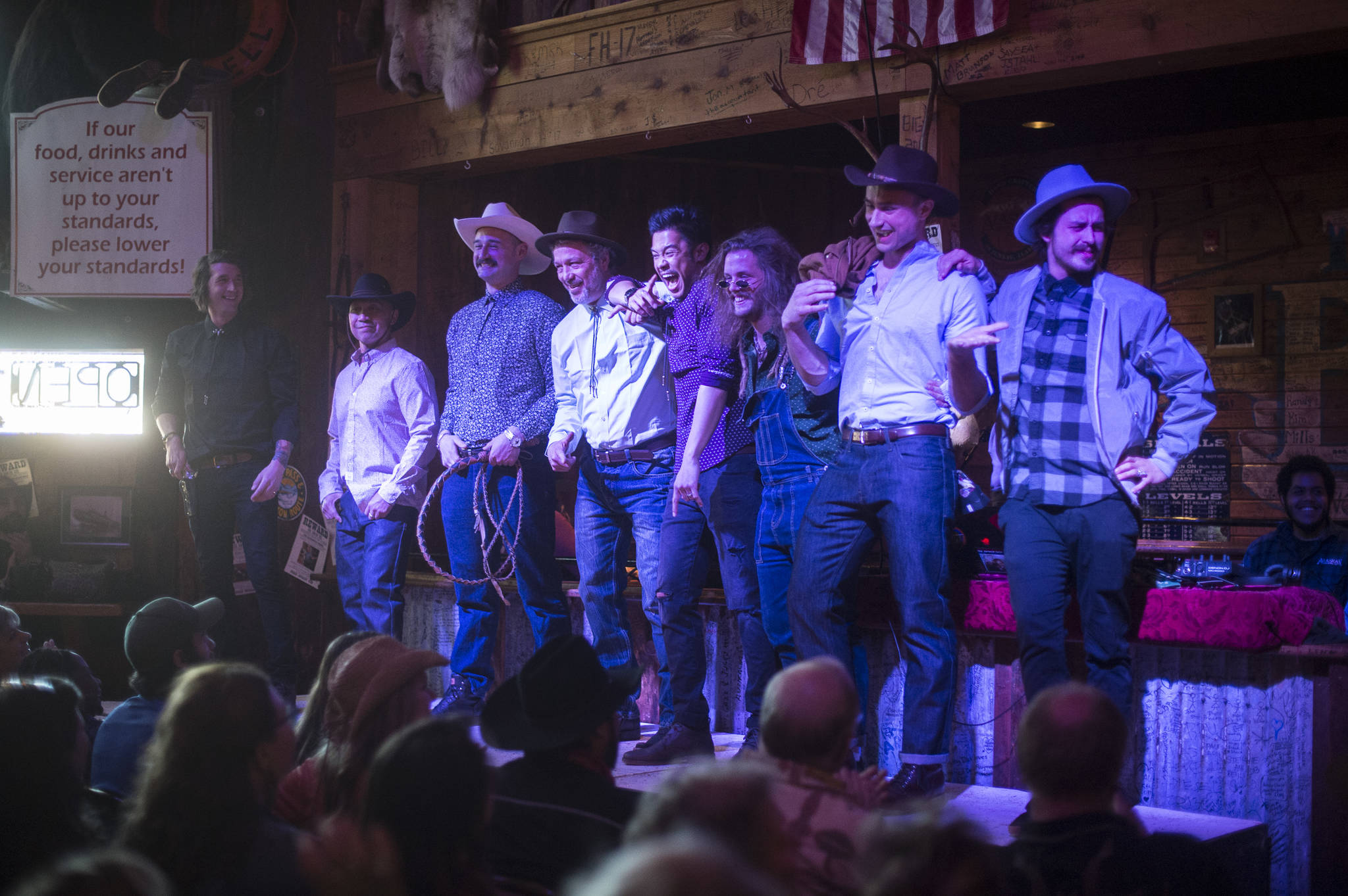 Men's clothing from 4th Coast Outfitters is modeled on stage during the Juneau Rotaract's Wild West Roundup Fashion Show at the Red Dog Saloon on Saturday, April 27, 2019. (Michael Penn | Juneau Empire)