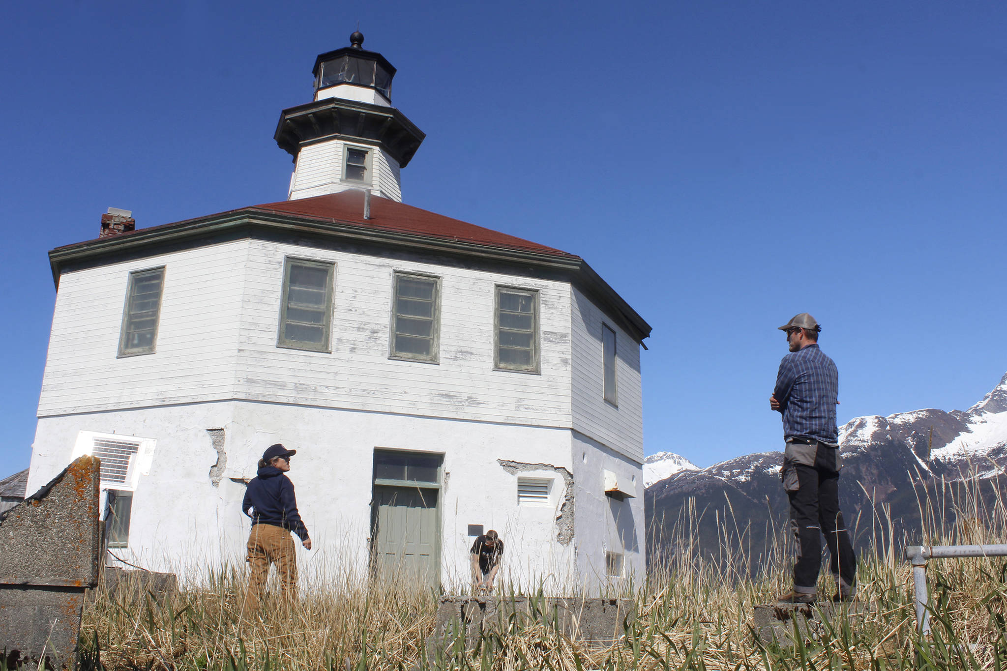 Eldred Rock Lighthouse Preservation Association Executive Director Sue York speaks to Marine Exchange of Alaska Field Operations Supervisor Nick Hatch at Eldred Rock Lighthouse on Monday, April 29, 2019. (Alex McCarthy | Juneau Empire)