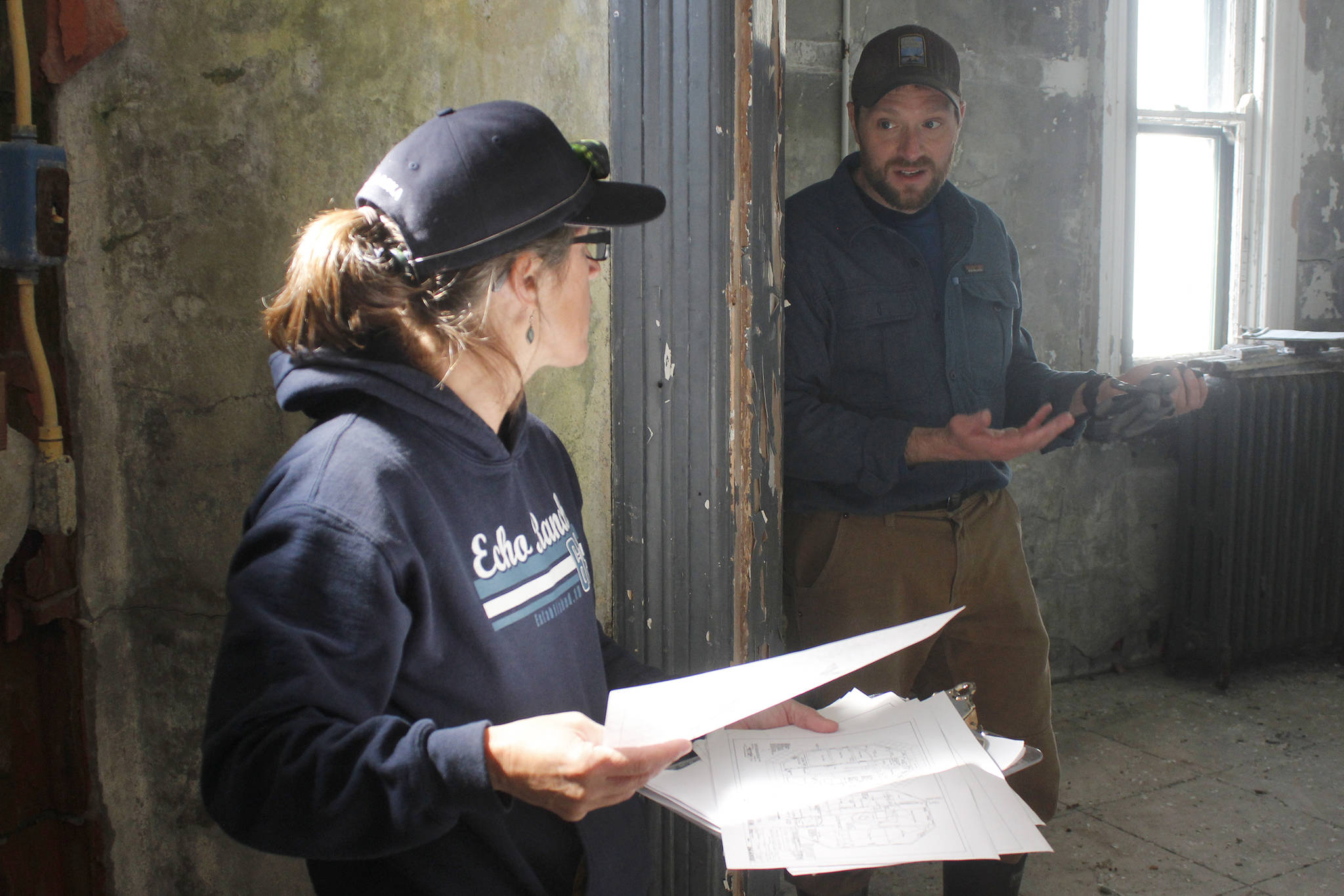 Eldred Rock Lighthouse Preservation Association Executive Director Sue York and Marine Exchange of Alaska's board representative Jonathan Wood share ideas at the Eldred Rock Lighthouse on Monday, April 29, 2019. (Alex McCarthy | Juneau Empire)