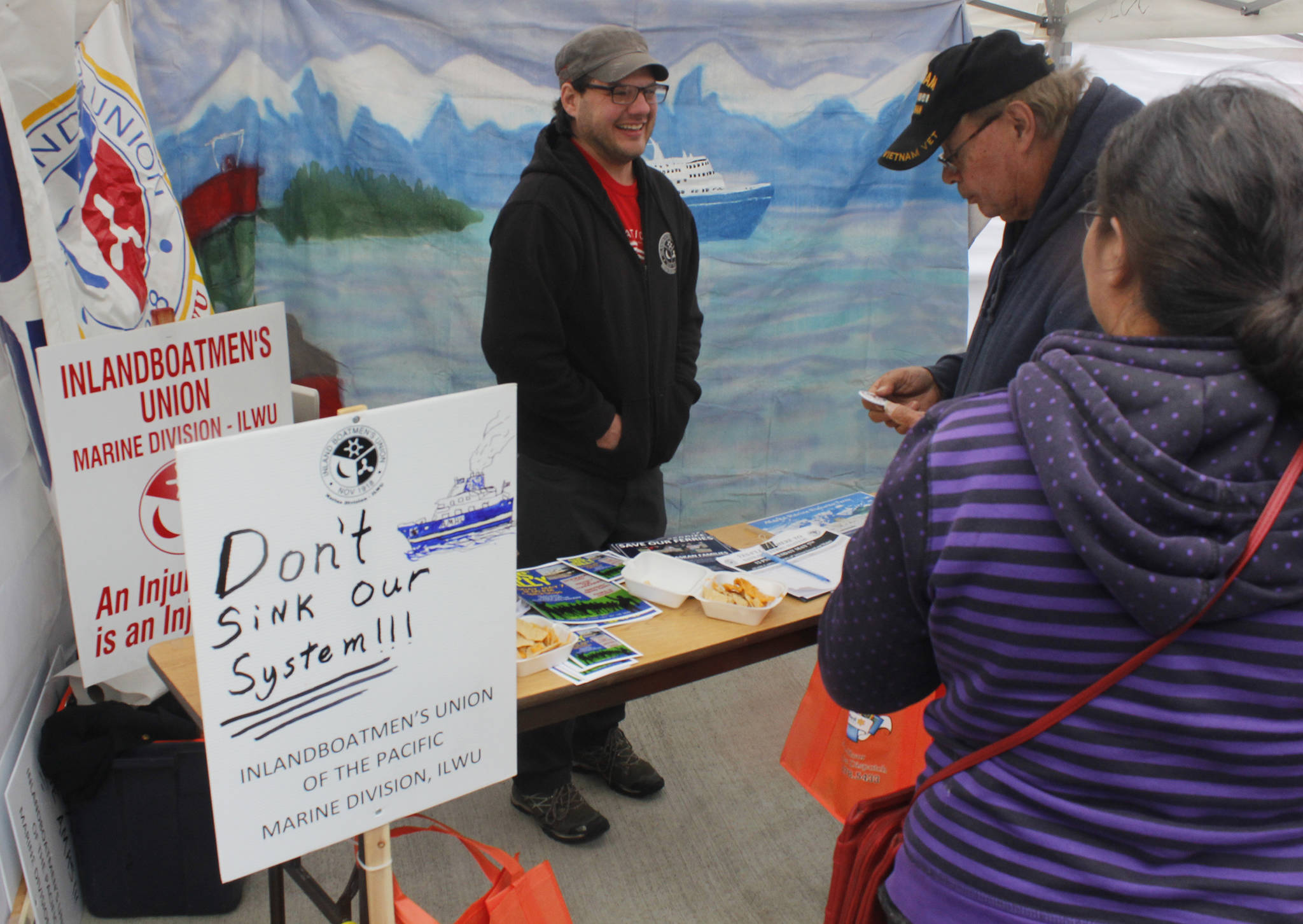 Anthony Distefano, a union steward for the Inlandboatmen's Union, talks to attendees at the Maritime Festival on Saturday, May 4, 2019. (Alex McCarthy | Juneau Empire)