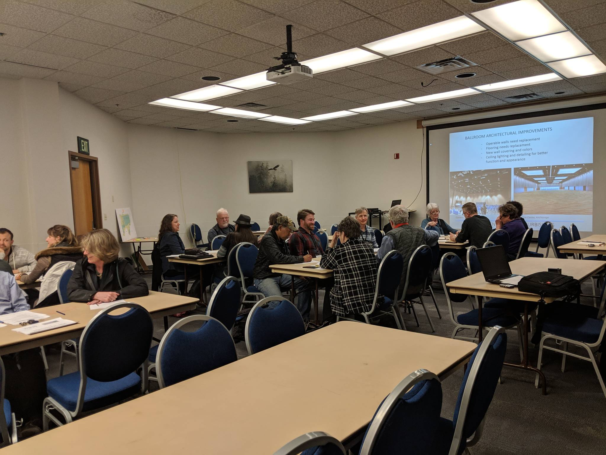 About two dozen people attended a May 7 public meeting about a Centennial Hall design options study. (Ben Hohenstatt | Juneau Empire)