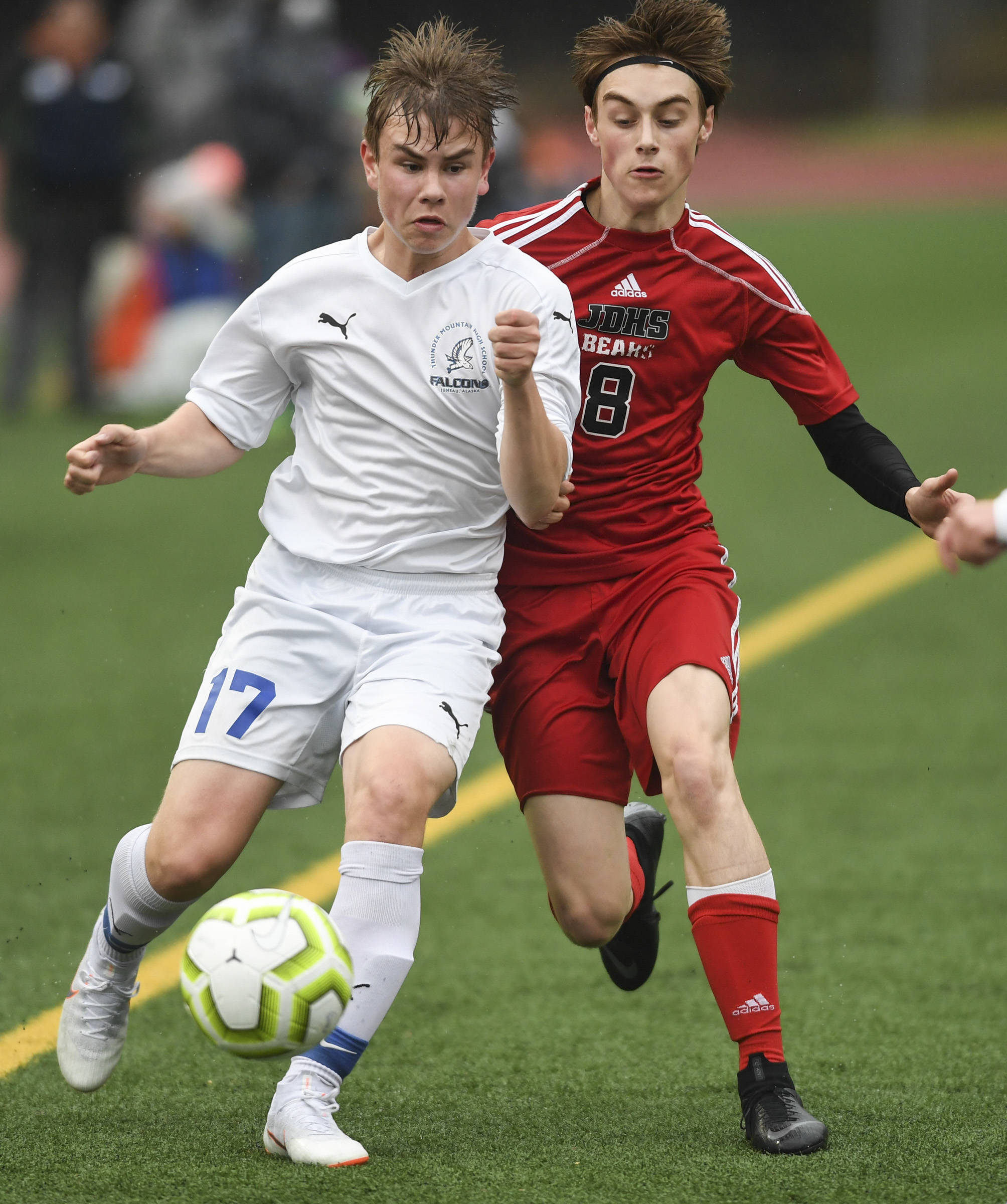 Thunder Mountain's Logan Miller, left, moves the ball against Juneau-Douglas' Koby Goldstein at Adair-Kennedy Memorial Field on Tuesday, May 7, 2019. The game ended tied at 1-1. (Michael Penn | Juneau Empire)
