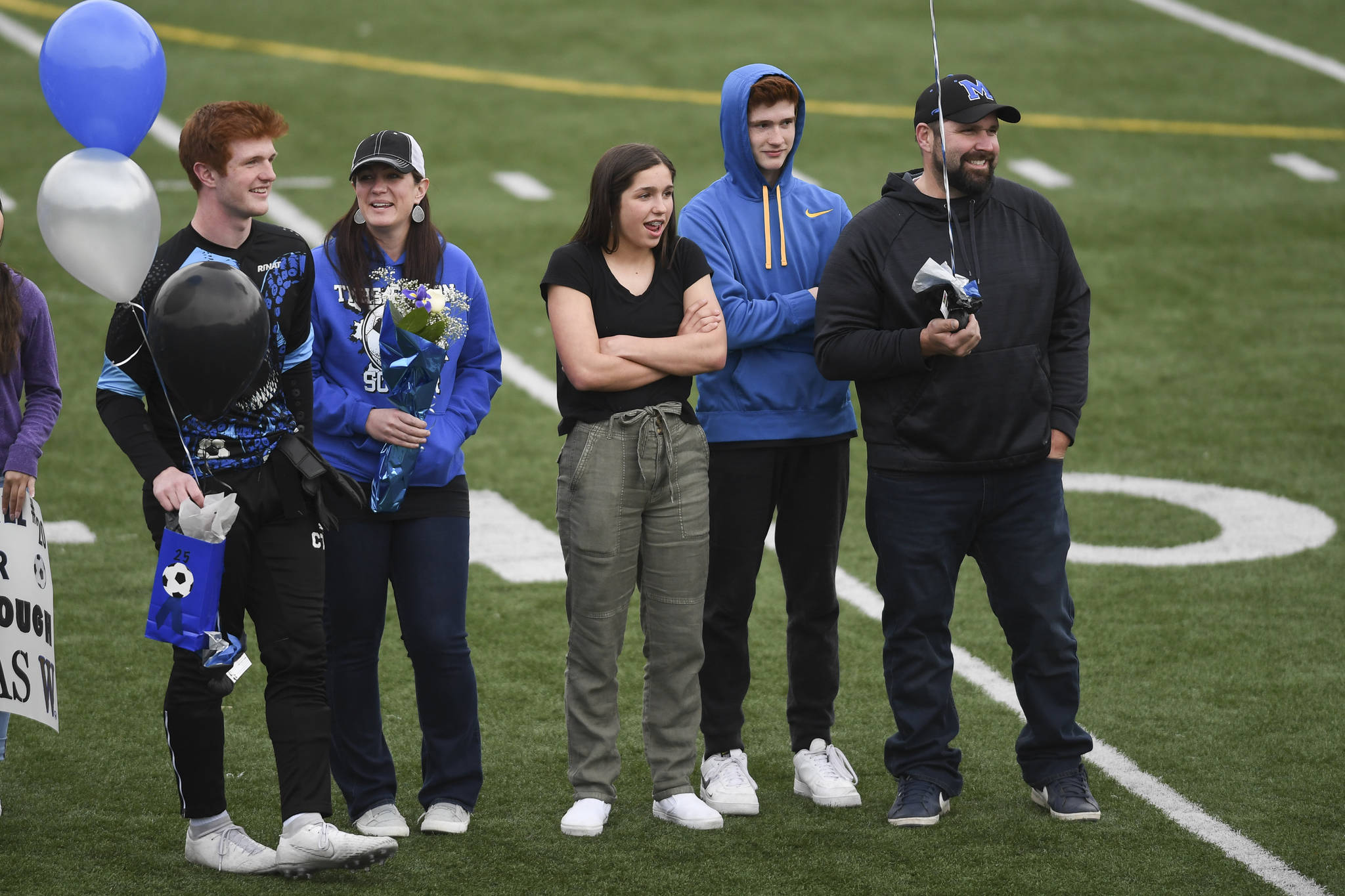 Thunder Mountain's Caleb Traxler celebrates Senior Night with his family at TMHS on Tuesday, May 14, 2019. (Michael Penn | Juneau Empire)