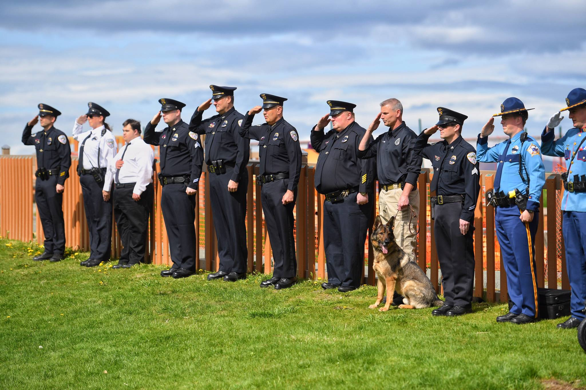 Juneau Police and Alaska State Troopers salute during a police memorial ceremony at Twin Lakes on Saturday, May 18, 2019. (Michael Penn | Juneau Empire)